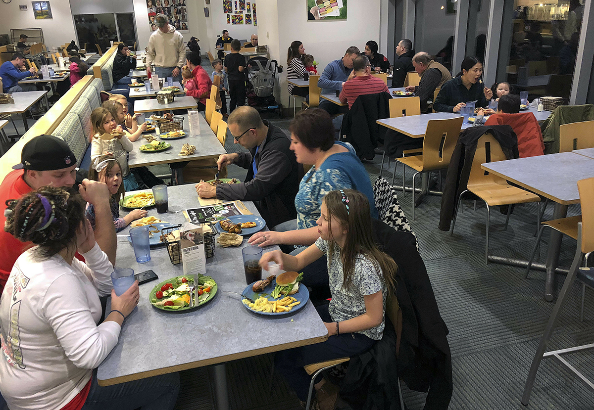 U.S. Coast Guard families enjoy a free dinner Jan. 15 at Roger Williams University in Bristol, R.I., following the first missed paycheck during the shutdown. (Jennifer McDermott/AP)