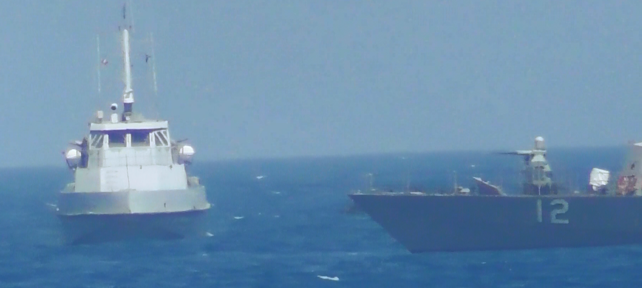 A U.S. Navy image released July 25 shows an Iranian Revolutionary Guard vessel crossing the bow of the U.S. patrol boat Thunderbolt in the Arabian Gulf. (U.S. Navy)