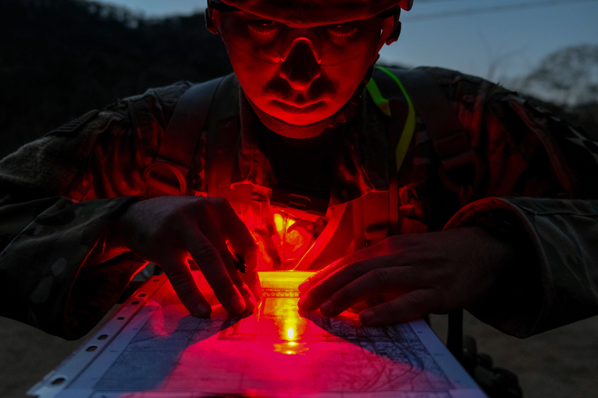Army Staff Sgt. Symon Bowlen uses his red lens flashlight to plot points for night land navigation during the 2nd Infantry Division Best Warrior Competition at Camp Casey, Republic of Korea, April 17, 2019. (Capt. Daniel Parker/Army)