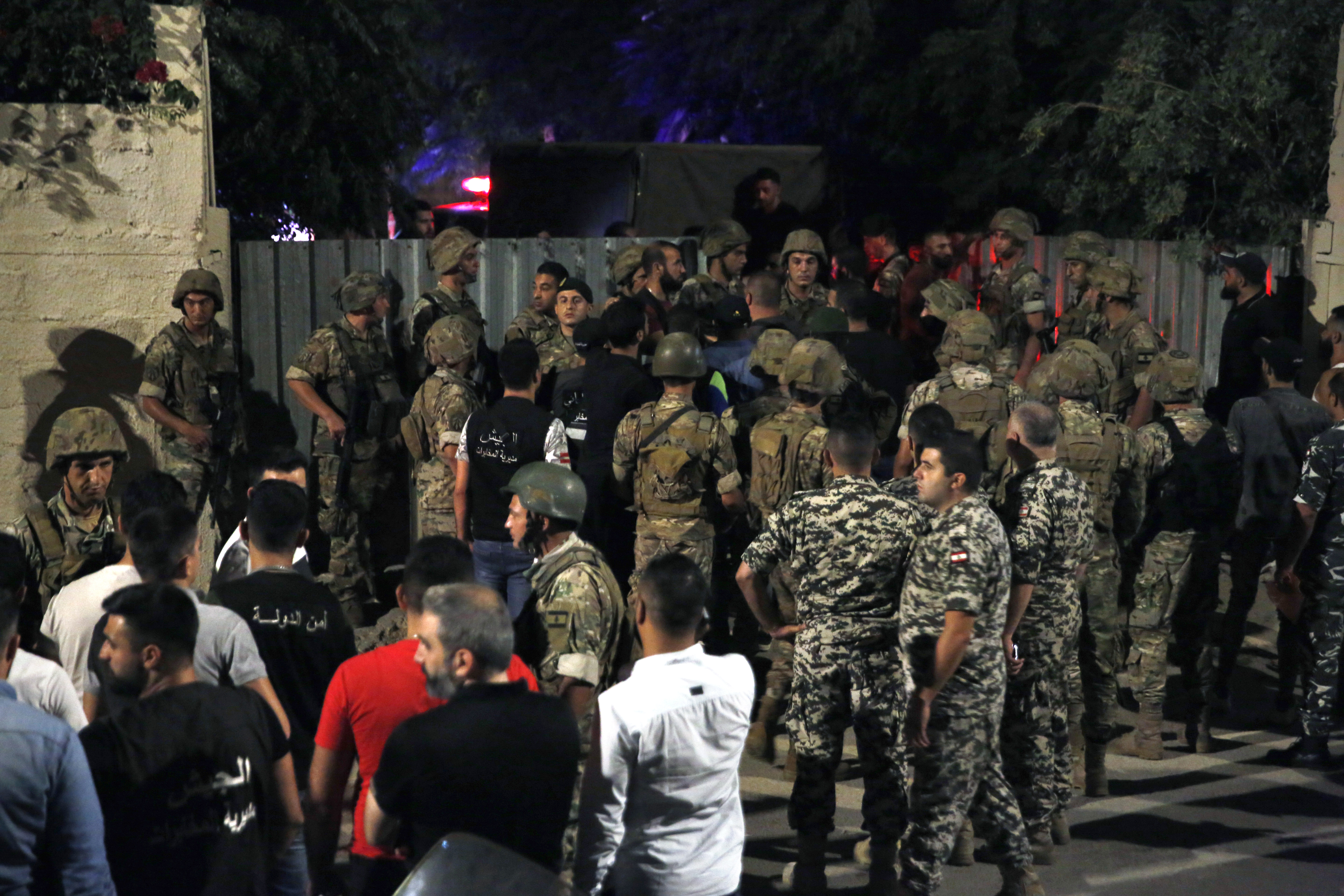 Lebanese security stand near the site where an Israeli drone was said to have crashed in a stronghold of the Lebanese Hezbollah group, in a southern suburb of Beirut, Lebanon, Sunday, Aug. 25, 2019. (Bilal Hussein/AP)