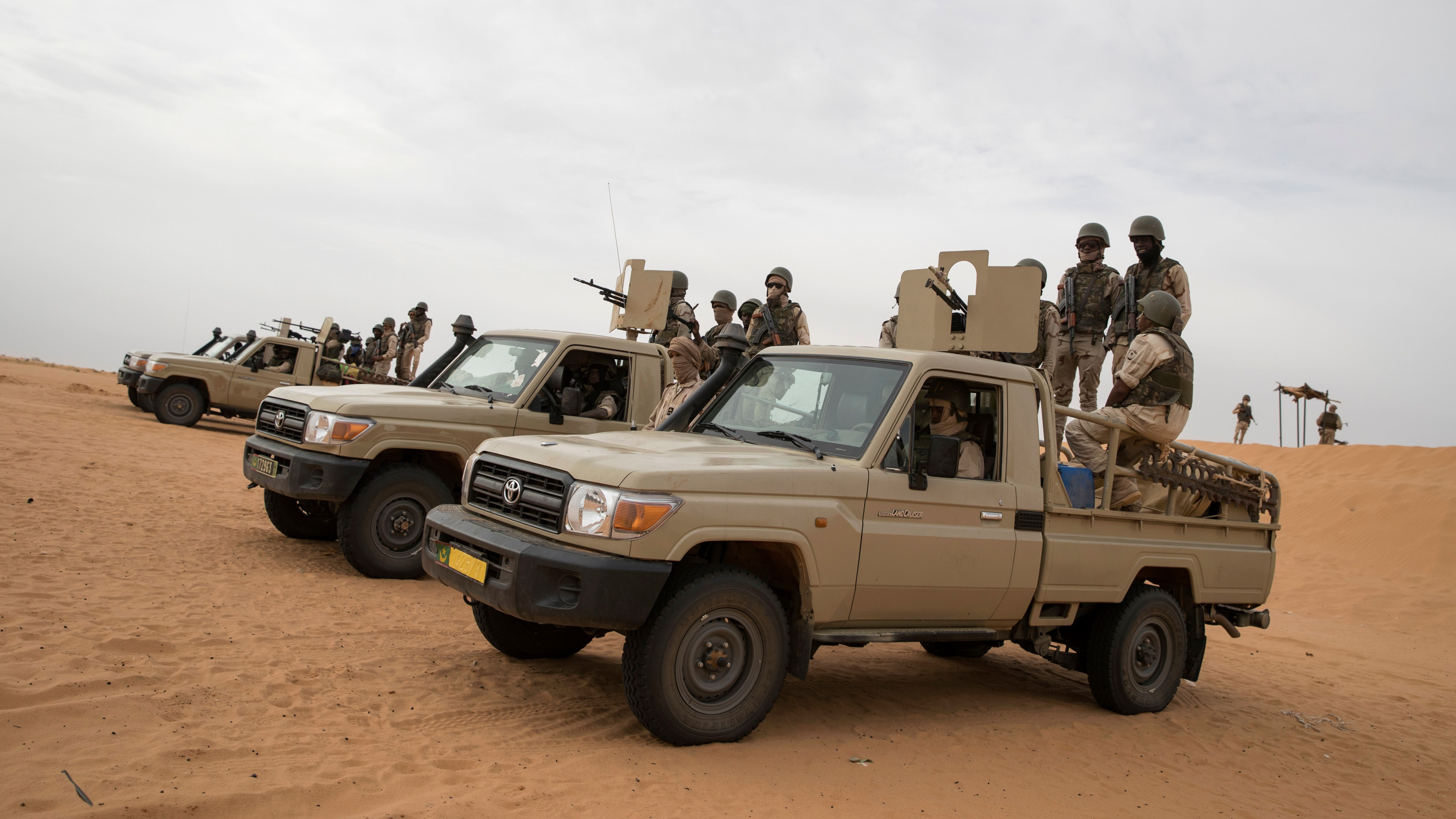 Soldiers of the Mauritania Army wait in armed vehicles at a G5 Sahel task force outpost in the southeast of Mauritania, along the border with Mali, on November 22, 2018. (THOMAS SAMSON/AFP/Getty Images)