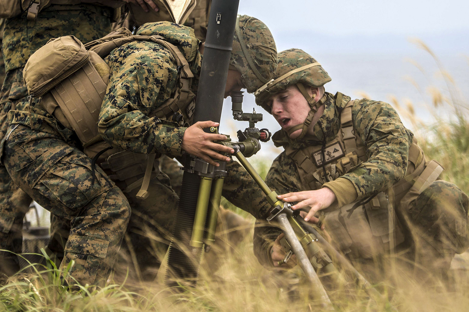 Marine Corps Lance Cpl. Felix Ruiz, left, and Marine Corps Lance Cpl. Devon Flynn, confirm the alignment of an 81mm mortar system at a range, Okinawa, on Dec. 21, 2017. (Cpl. Bernadette Wildes/Marine Corps)