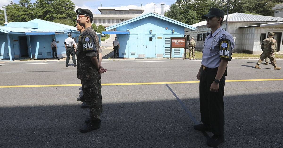 South Korean soldiers stand guard at the border village of Panmunjom in the Demilitarized Zone on September 7, 2018. - The leaders of the two Koreas will hold a summit in Pyongyang in September, Seoul said on September 6, as Kim Jong Un renewed his commitment to the denuclearisation of the flashpoint peninsula. (AHN YOUNG-JOON/AFP/Getty Images)
