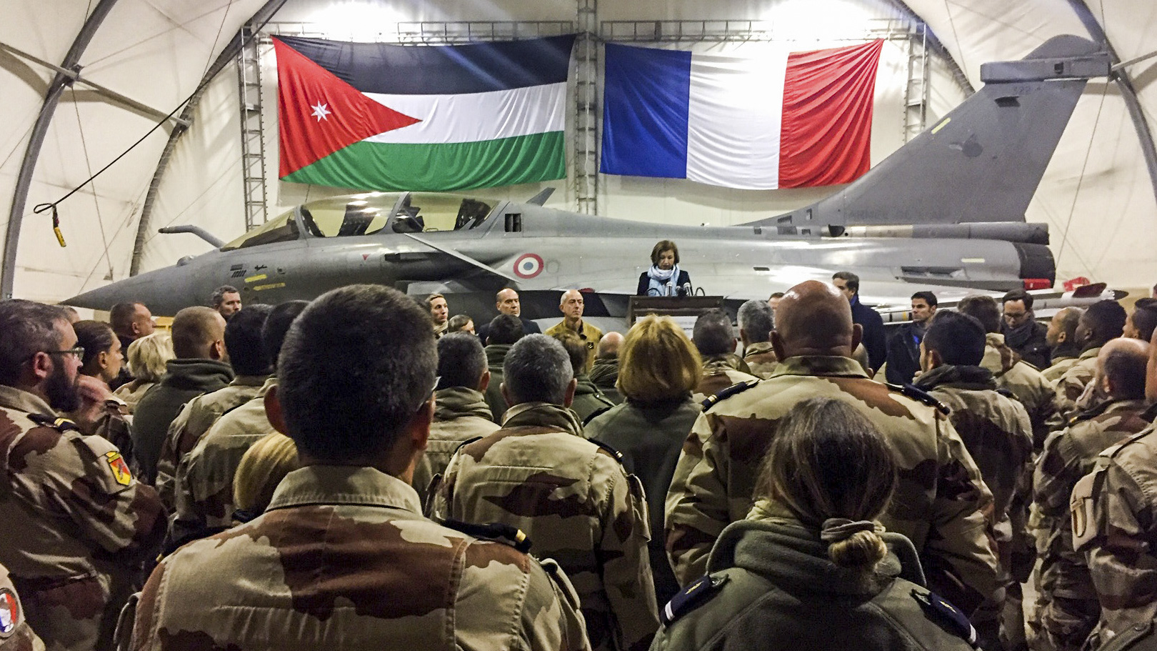 French Defence Minister Florence Parly (C) gives an address as she stands next to the Chief of Staff of the French Air Force, General Philippe Lavigne (C-L), before a Dassault Rafale fighter-bomber aircraft during her visit to the Royal Jordanian Air Force's Prince Hassan Air Base (H5), northeast of the capital Amman, on December 31, 2018, from which French fighter jets take-off for sorties within their capacity in the international coalition against the Islamic State (IS) group. (DAPHNE BENOIT/AFP/Getty Images)