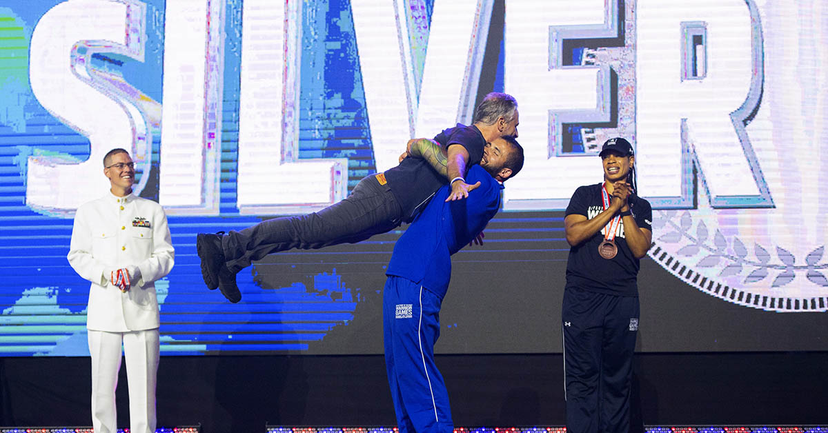 Air Force SrA Rafael Morfinenciso lifts John Stewart after receiving the Silver Medal as Ultimate Champion during Closing Ceremony at the 2018 Department of Defense Warrior Games June 9, 2018 at the Air Force Academy in Colorado Springs, Colo. The DoD Warrior Games are an annual event, established in 2010, to introduce wounded, ill and injured service members to adaptive sports as a way to enhance their recovery and rehabilitation. (Mark Reis/DoD)