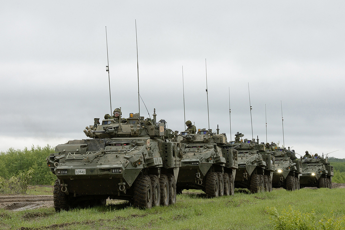 Canadian light armored vehicles, developed by General Dynamics, move in a convoy in the Wainwright Garrison training area during Exercise Maple Resolve (Sgt Jean-Francois Lauzé, Garrison Imaging Petawawa)