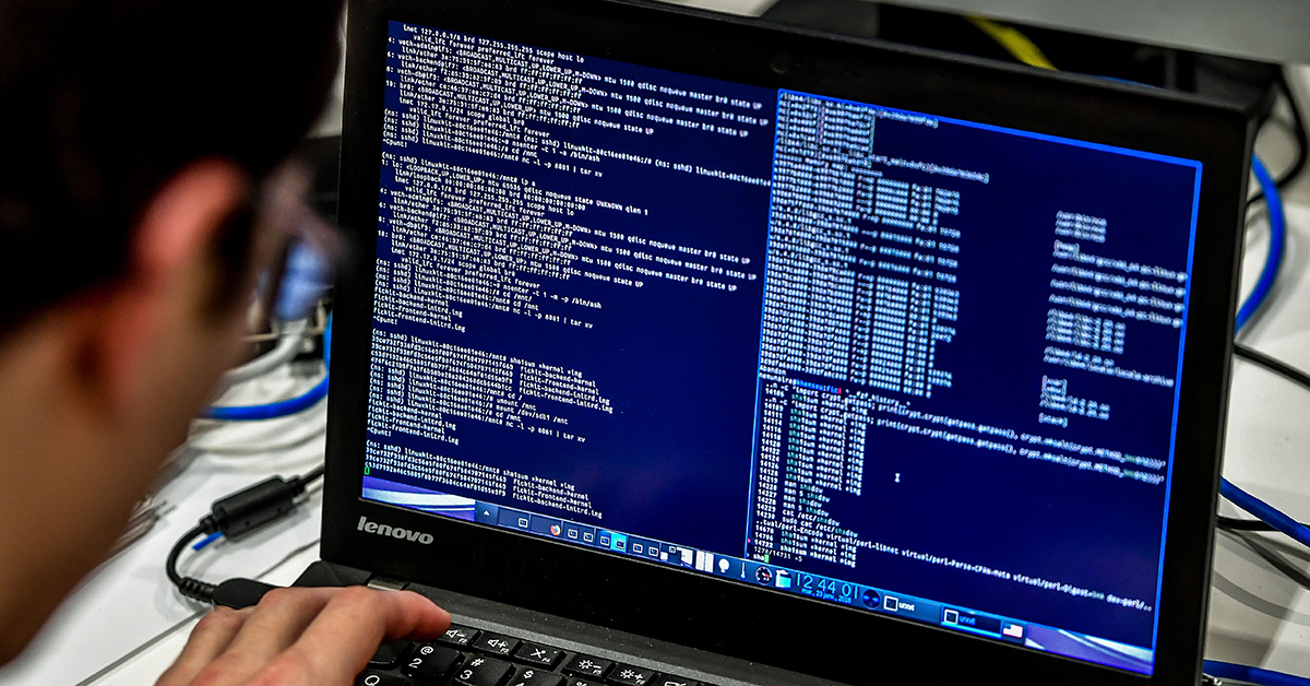 A person works at a computer during the 10th International Cybersecurity Forum in Lille on Jan. 23, 2018. (Philippe Huguen/AFP/Getty Images)