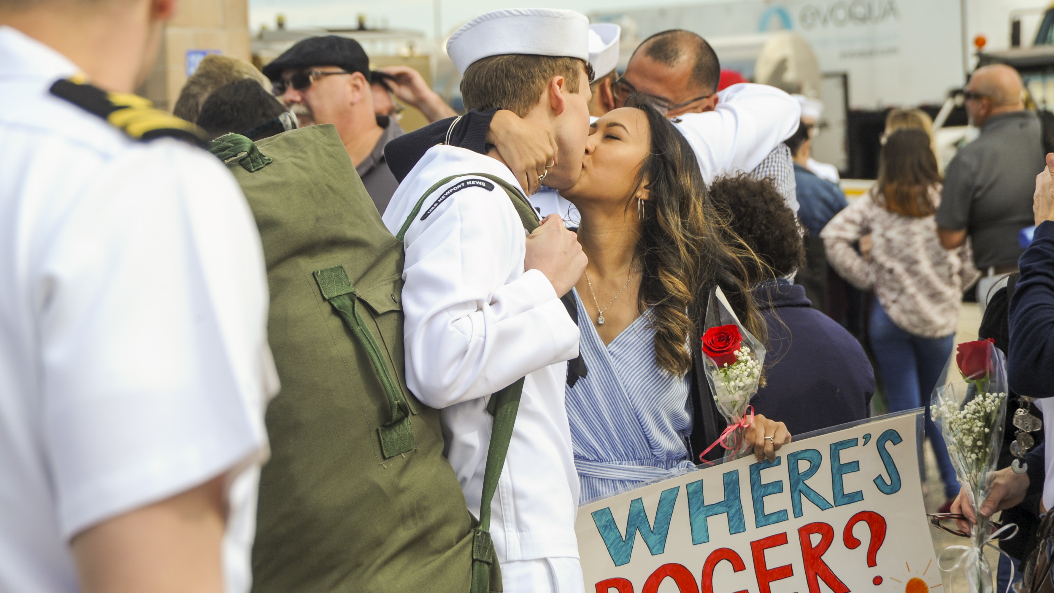 A Sailor assigned to the Los Angeles-class attack submarine USS Newport News (SSN 750) receives kiss from a loved one, at Naval Station Norfolk, after returning from a seven month deployment to the U.S. 6th Fleet area of operations. (MC Darryl Wood/Navy)