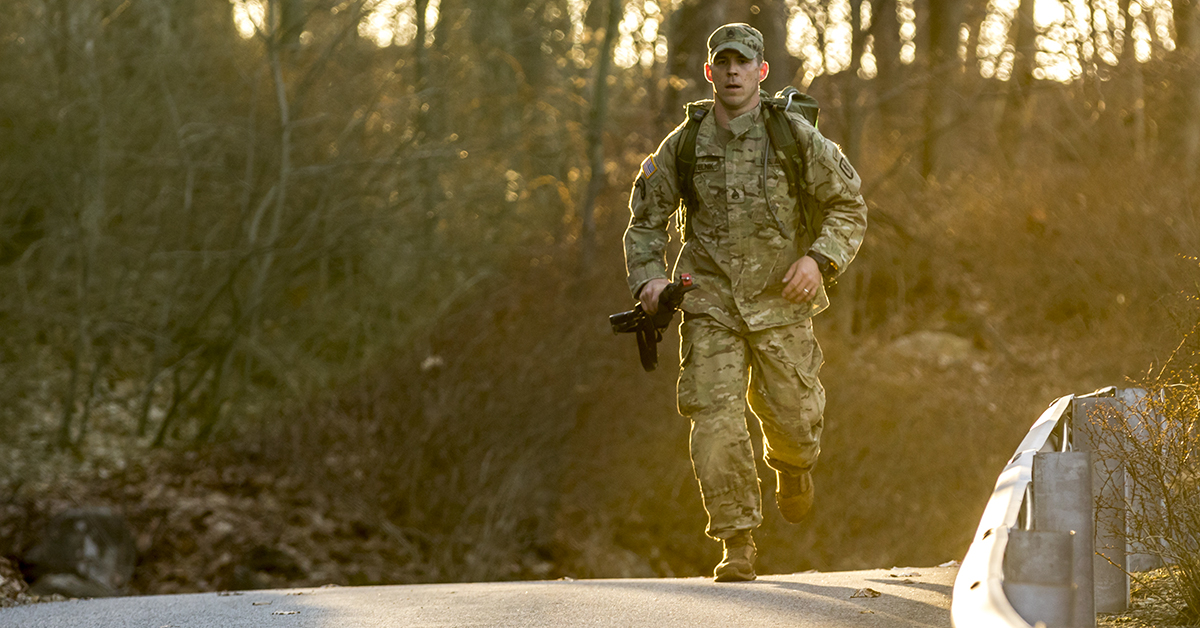 Army Staff Sgt. Michael Kostelnik, an infantryman assigned to the 106th Infantry Regiment, Regional Training Institute, New York Army National Guard (NYARNG), competes in the 12-mile Road March portion of the state-level NYARNG Best Warrior Competition at West Point, N.Y., April 21, 2018. The Best Warrior Competition, held April 18-22, 2018, is an annual event in which junior enlisted Soldiers and non-commissioned officers from various units compete in several events intended to test their military skills and knowledge, as well as their physical fitness and endurance. (Staff Sgt. Michael Davis/Army National Guard)