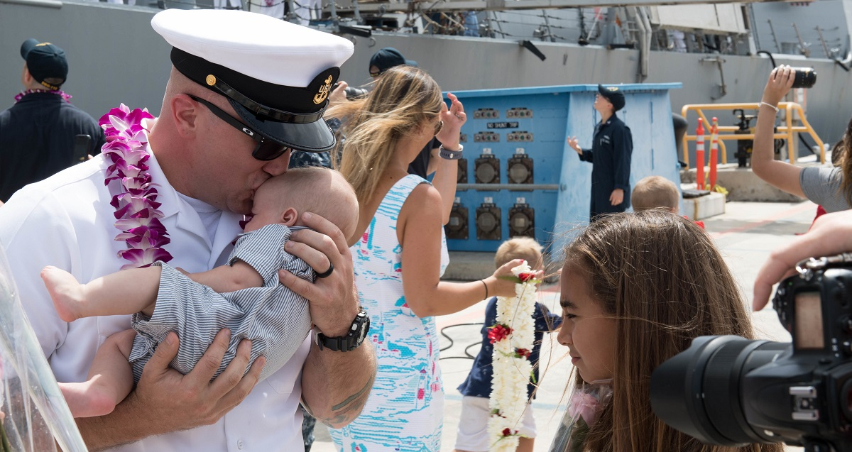 This year's Blue Star Families survey is open to members of the military community through May 25. Here, Chief Fire Controlman (Aegis) Torry Harrison is welcomed by his son and daughter during the homecoming celebration for the destroyer Michael Murphy. (MC3 Jessica O. Blackwell/Navy)