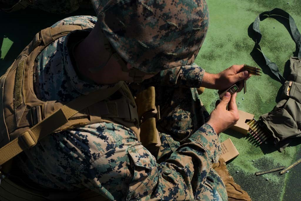 A Marine loads rifle rounds into his magazine. Soon some Marines will be sporting a new mag pouch from High Speed Gear. (U.S. Marine Corps photo by Lance Cpl. Kolby Leger)