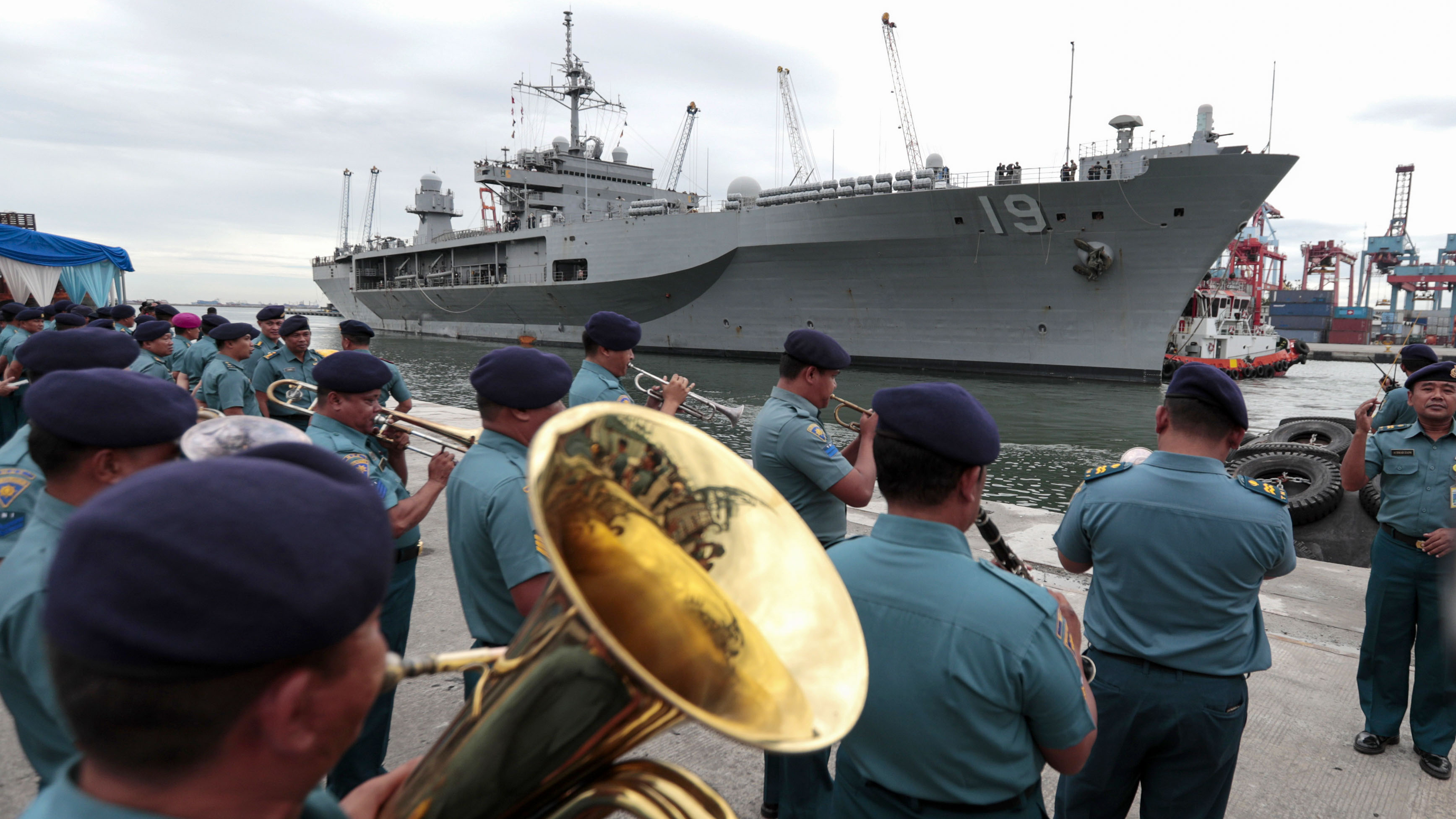 Indonesian Navy band plays as U.S. Navy ship USS Blue Ridge prepares to dock at Tanjung Priok Port in Jakarta, Indonesia, Wednesday, May 1, 2019. The flagship of the U.S. Seventh Fleet which is also the oldest operational ship in the U.S. Navy arrived Wednesday in Jakarta for a five-day visit in the country. (AP Photo/Dita Alangkara)