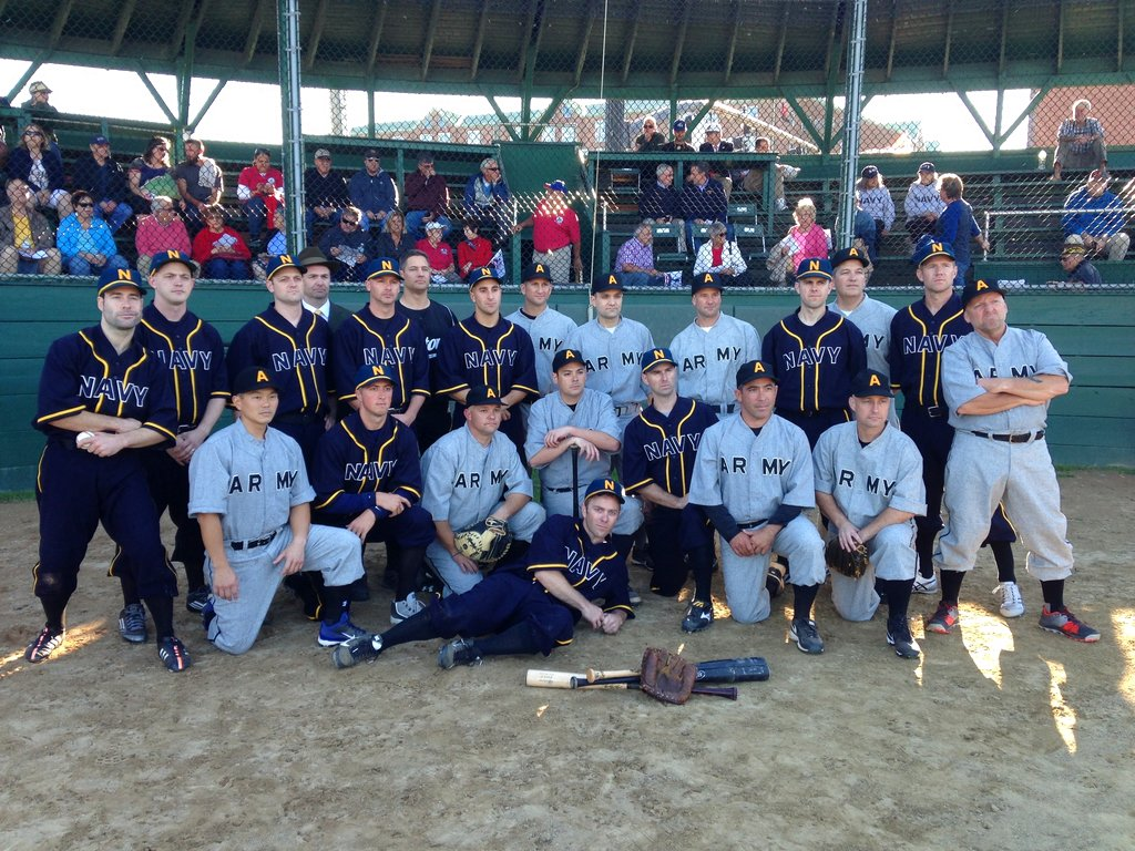 U.S. Naval War College students pose for a group photo before an Army versus Navy baseball game Friday, Sept. 29, 2017, in Newport, R.I. (Jennifer McDermott/AP)
