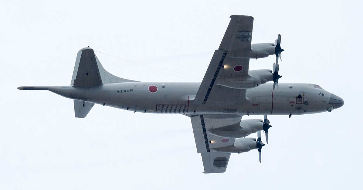This picture taken on January 12, 2020 shows Lockheed P-3C maritime surveillance aircraft from Japan's Maritime Self-Defence Force taking part in an airborne exercise of the Ground Self-Defence Force 1st Airborne Brigade at Narashino training ground in Funabashi, Chiba prefecture. (Photo by KAZUHIRO NOGI/AFP via Getty Images)