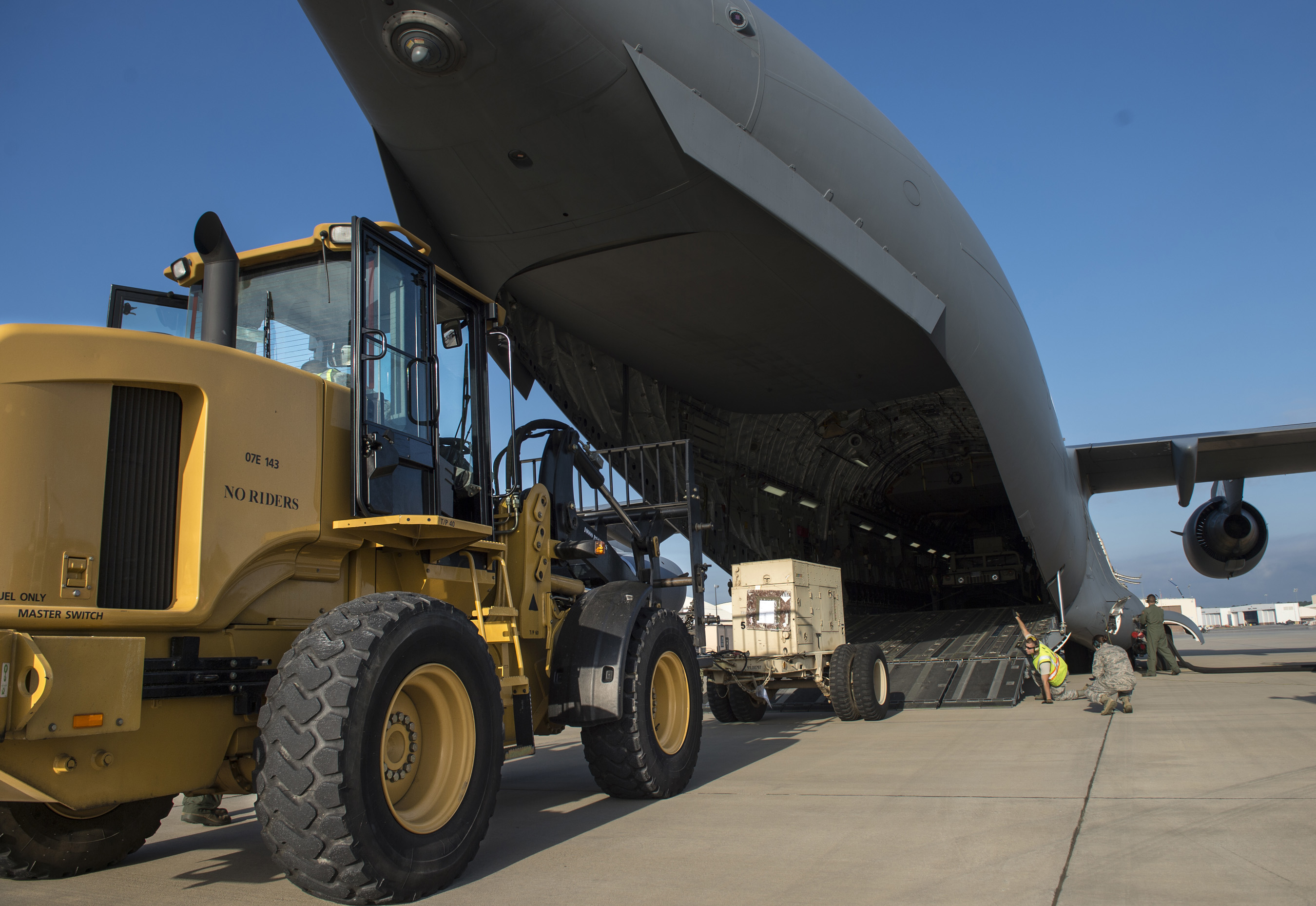 The 78th Logistics Readiness Squadron loads a generator onto a C-17 Globe Master II in preparation to provide humanitarian aid in Ecuador on April 26, 2016, at Robins Air Force Base, Ga. (Airman 1st Class Justin Parsons/U.S. Air Force)