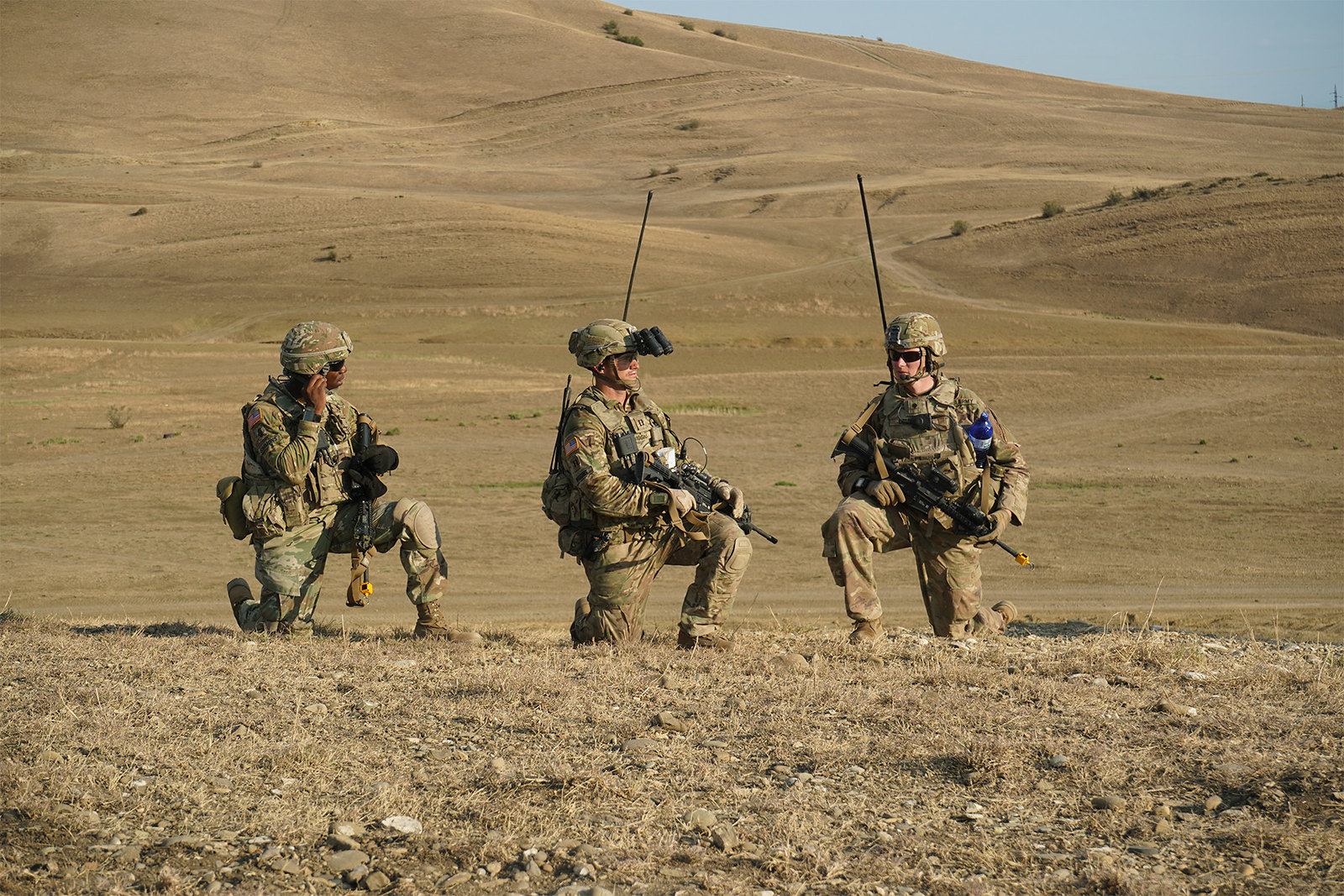 Three soldiers prepare to begin a live-fire exercise near Tbilisi, Georgia, Aug. 4, 2019. (Sgt. LaShic Patterson/Army)