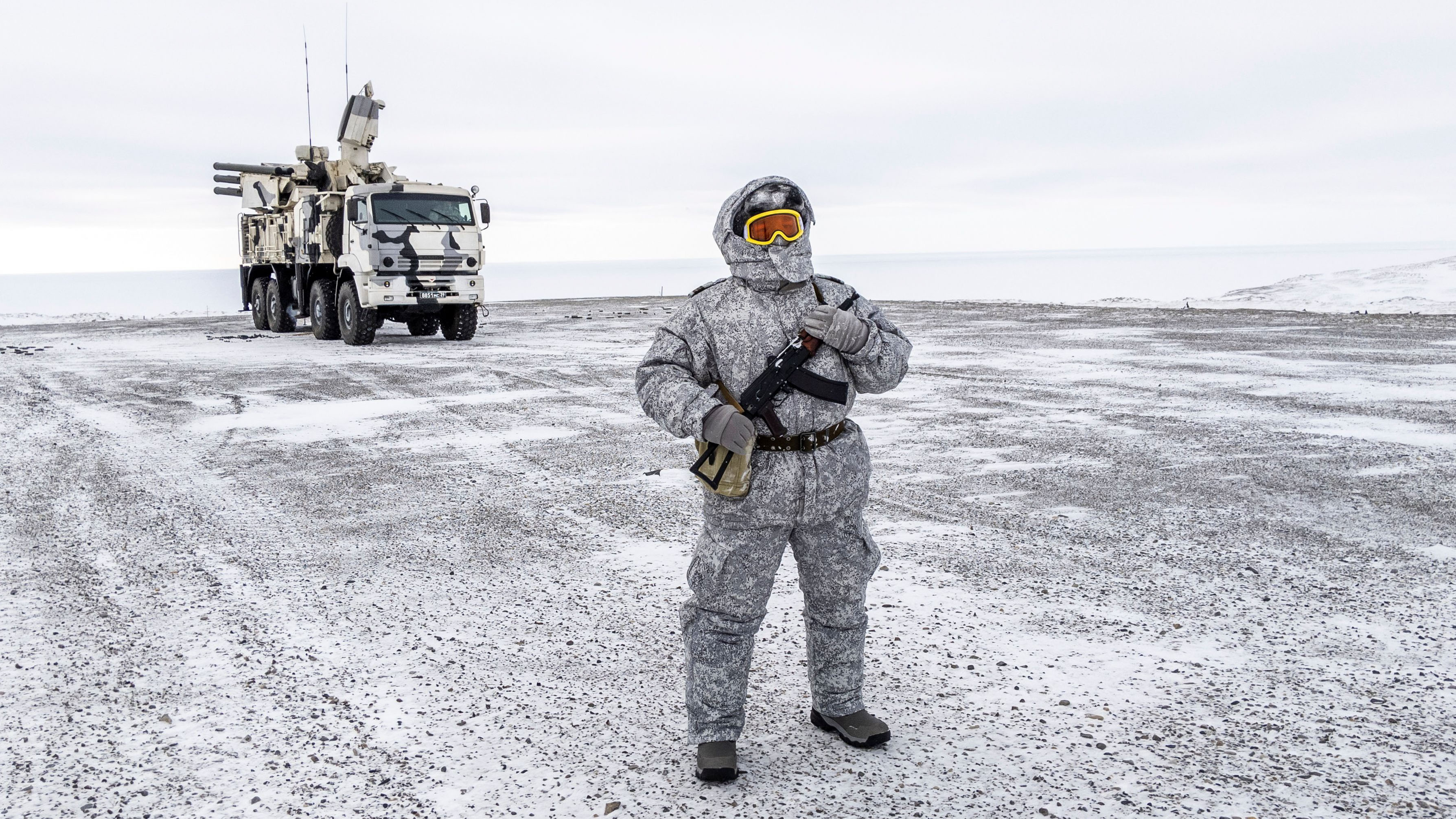 A soldier holds a machine gun as he patrols the Russian northern military base on Kotelny island, beyond the Artic circle on April 3, 2019. - The Russian military base dubbed the
