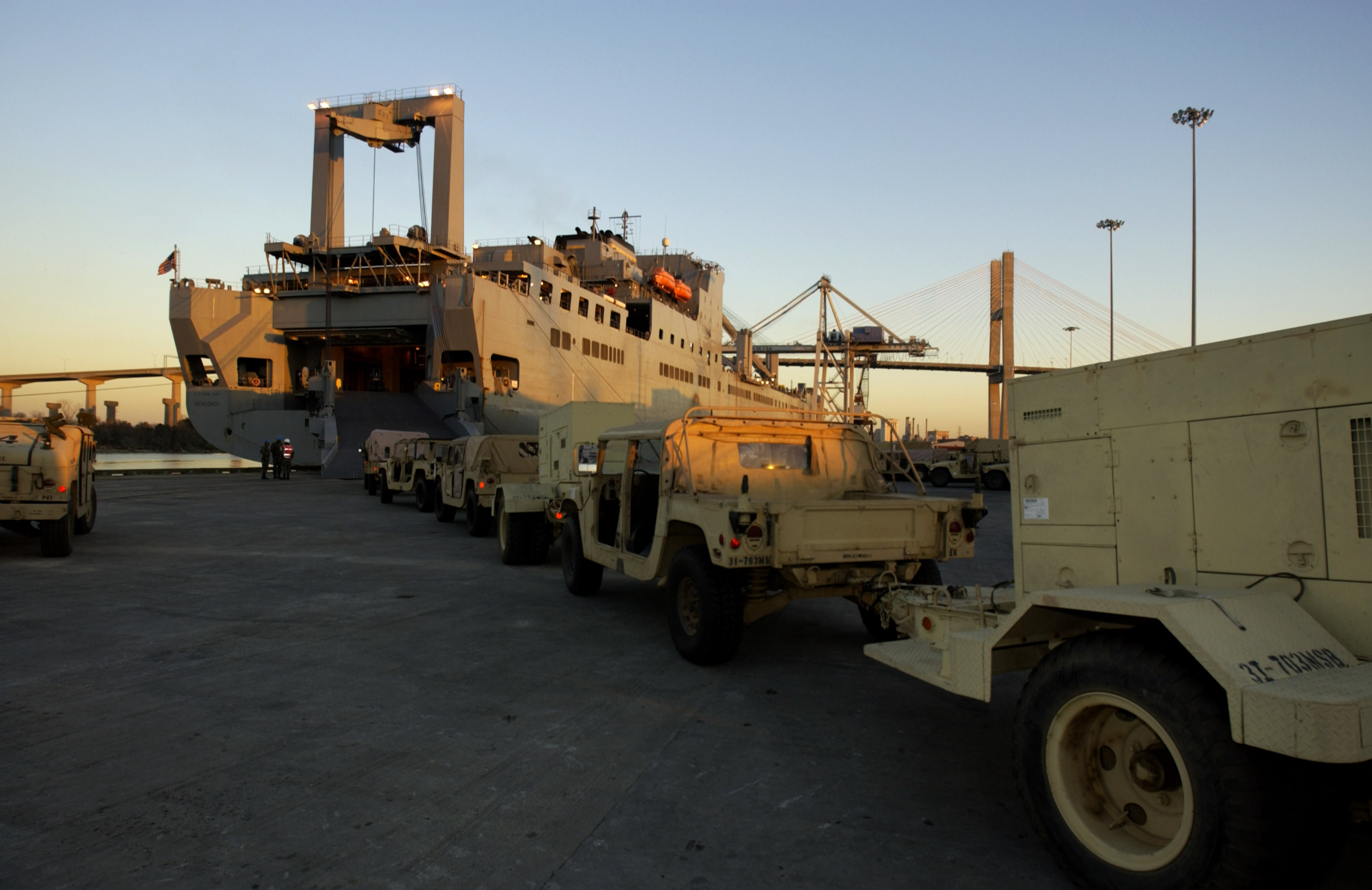 A line of U.S. Army Humvees waits on a dock at the Port of Savannah, Ga., in 2003. The USNS Mendonca was being loaded with military hardware bound for the Arabian Gulf. The Army uses sealift to transport 90 percent of its gear. (Stephen Morton/Getty Images)