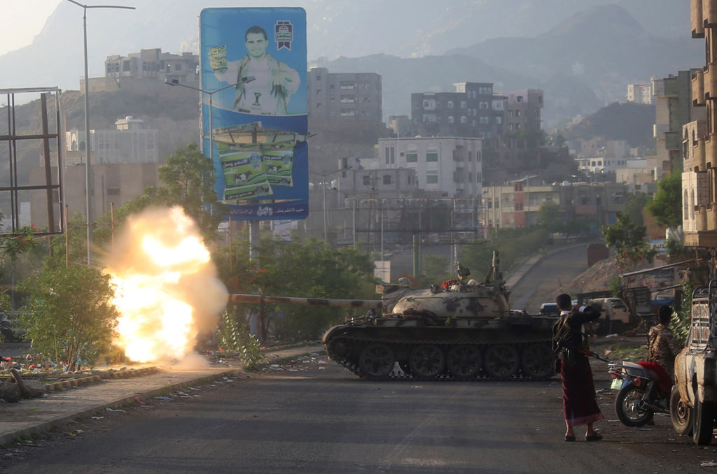 Yemeni fighters loyal to the country's exiled President Abedrabbo Mansour Hadi fire from a tank during clashes with Shiite Huthi rebels in the country's third-city of Taez on May 30, 2019. - Taez, in southern Yemen, is under siege by the Huthis but controlled by pro-government forces, who are supported by the military coalition led by Saudi Arabia and the United Arab Emirates. (AHMAD AL-BASHA/AFP/Getty Images)