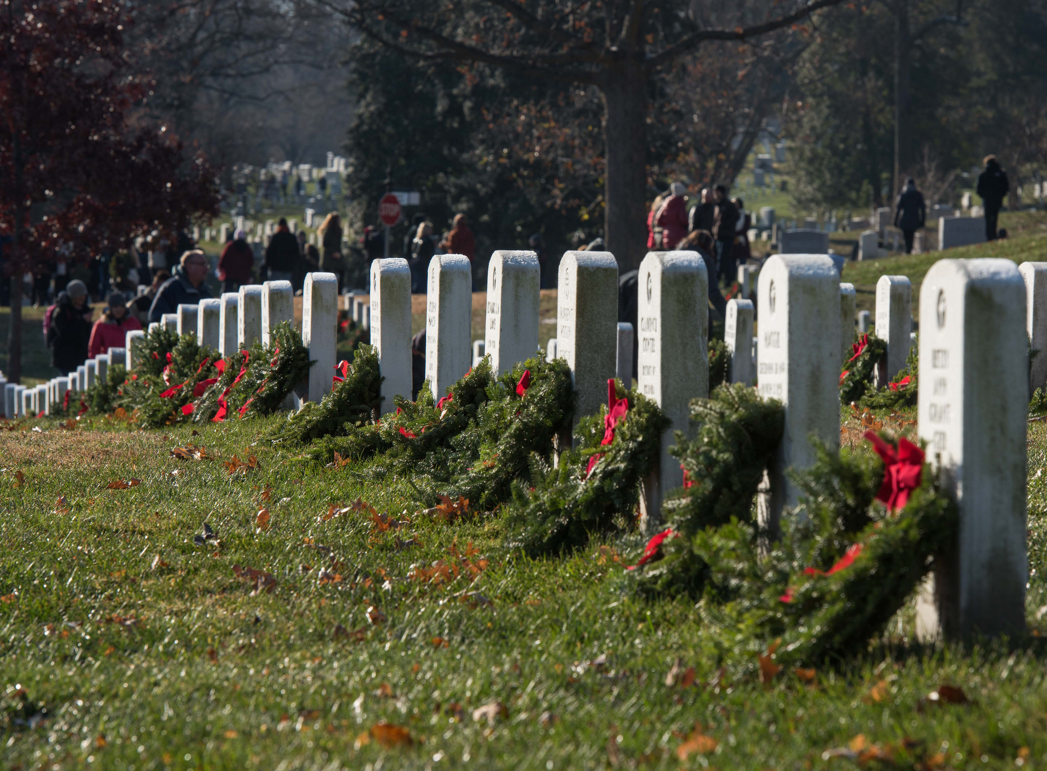 Service members and volunteers participate in Wreaths Across America at Arlington National Cemetery, Va., Dec. 16, 2017. (Sgt. George Huley/Army)