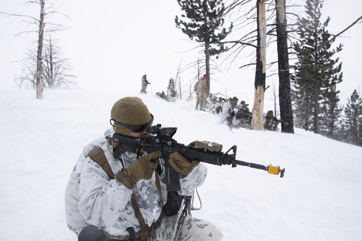 U.S. Marines take their positions during advanced cold-weather training at the Marine Corps Mountain Warfare Training Center Sunday, Feb. 10, 2019, in Bridgeport, Calif. After 17 years of war against Taliban and al-Qaida-linked insurgents, the military is shifting its focus to better prepare for great-power competition with Russia and China, and against unpredictable foes such as North Korea and Iran. (Jae C. Hong/AP)