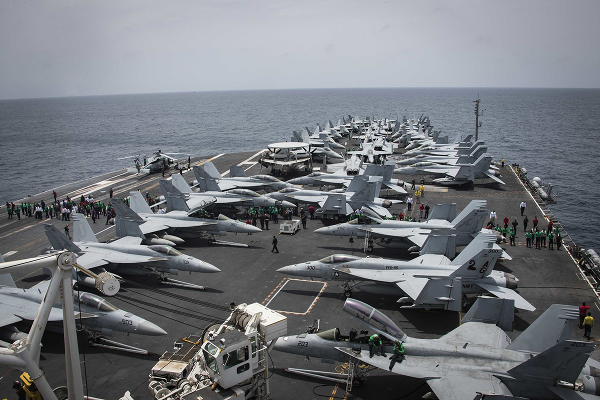 Sailors partake in a foreign object and debris walk-down on the flight deck of the Nimitz-class aircraft carrier USS Abraham Lincoln on May 19, 2019, in the Arabian Sea. (Mass Communication Specialist 3rd Class Garrett LaBarge/U.S. Navy via AP)