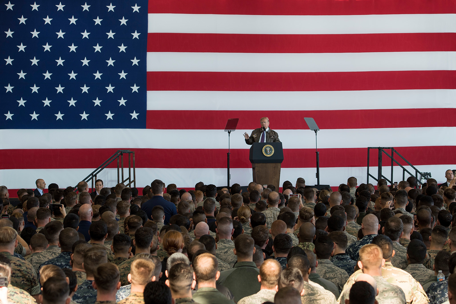 President Donald Trump speaks to service members and their families during a troop talk on Nov. 5, 2017, at Yokota Air Base, Japan. (Senior Airman Donald Hudson/Air Force)