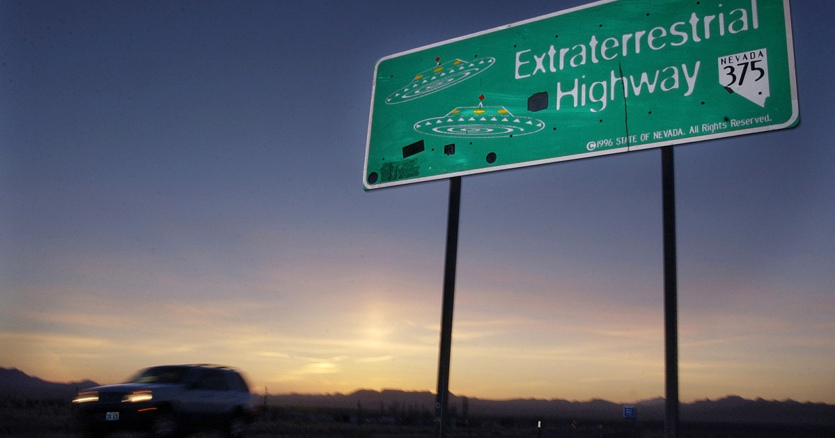 A car moves along the Extraterrestrial Highway near Rachel, Nev., the closest town to Area 51. More than 1.4 million have signed up to