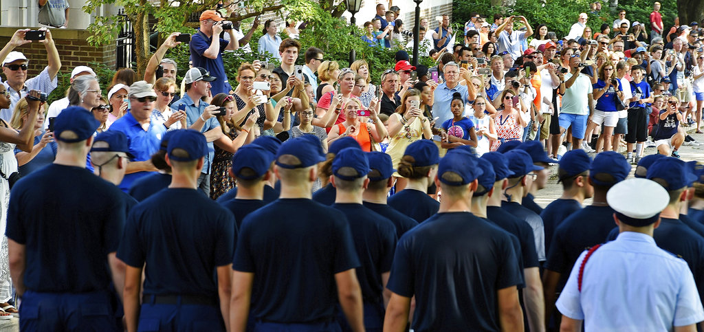 Family members line Bear Drive to get photos of their swabs as they march out for their swearing-in ceremony during Day 1 of Swab Summer for the U.S. Coast Guard Academy Class of 2022 on July 2, 2018, at the academy in New London, Conn. The seven-week Swab Summer introduces the newest class to military academy life. Day 1 includes haircut, uniform issue and drills in teamwork and discipline. (Sean D. Elliot/The Day via AP)