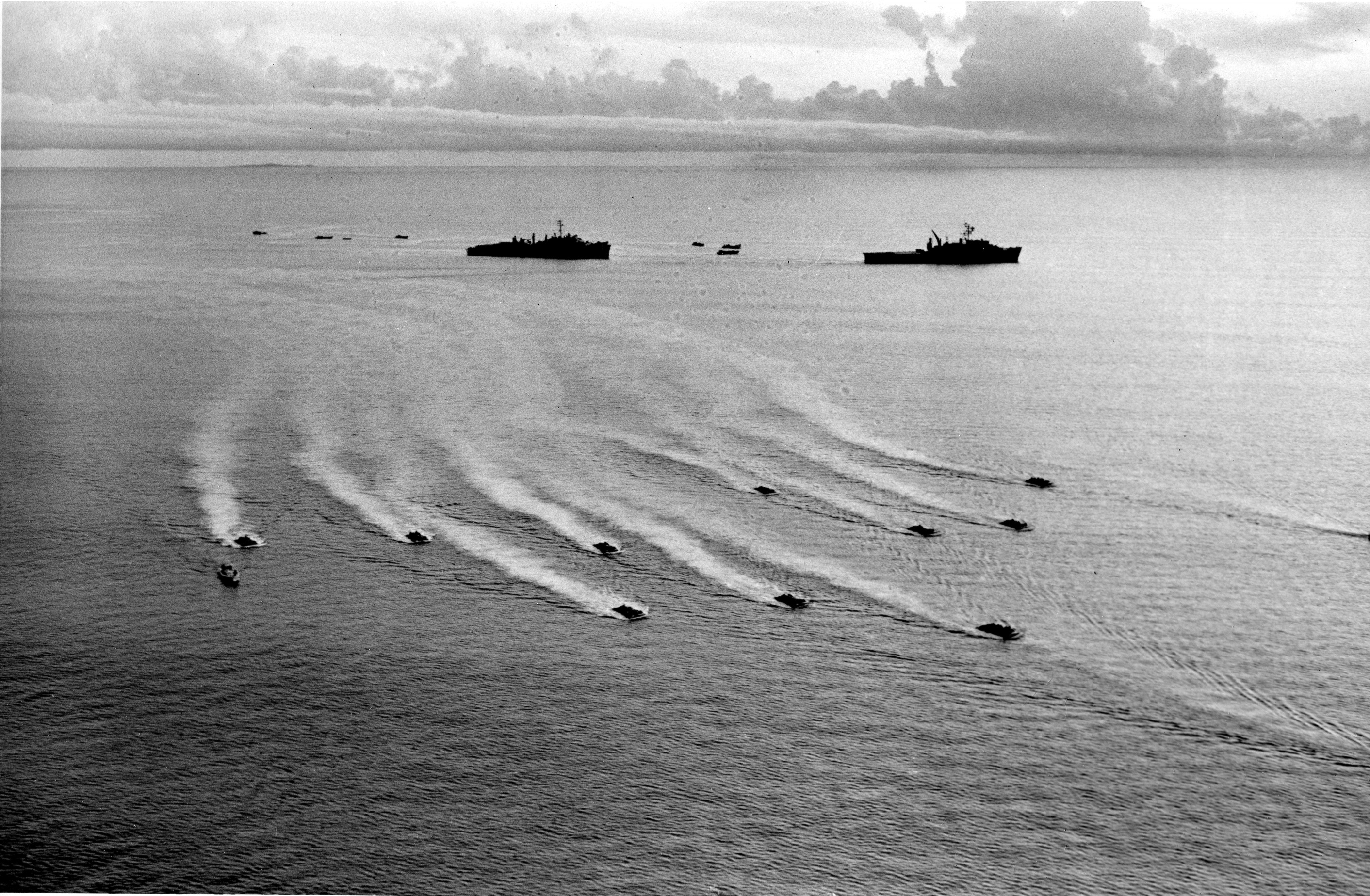 U.S. Marines are brought ashore to in a swarm of landing crafts near the Vietnam demilitarized zone on Sept. 15, 1966. (Henri Huet/AP)