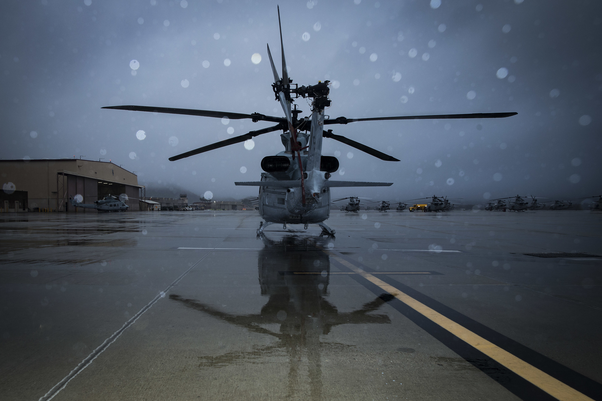 Rain drenches a UH-1Y Venom helicopter on the flight line at Marine Corps Air Station Camp Pendleton, Calif., Jan. 16, 2019. (Lance Cpl. Drake Nickels/Marine Corps)