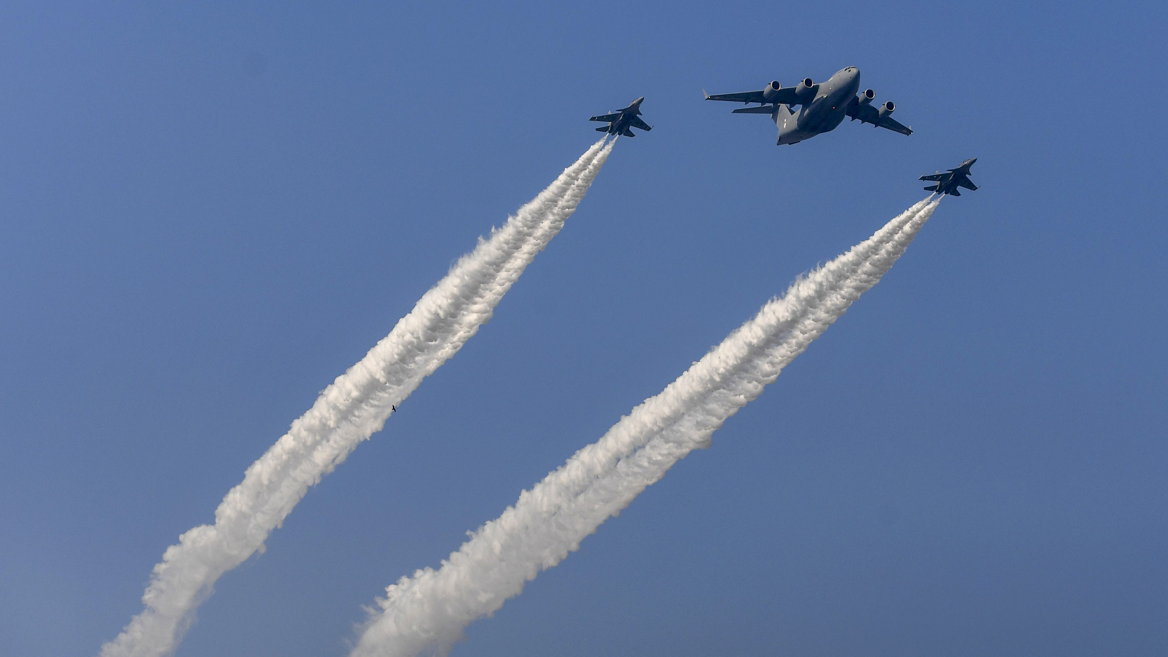 Indian fighter jets fly in formation with a C-17 Globemaster as they fly past during the Republic Day parade in New Delhi on January 26, 2019. - India celebrated its 70th Republic Day. (PMONEY SHARMA/AFP/Getty Images)