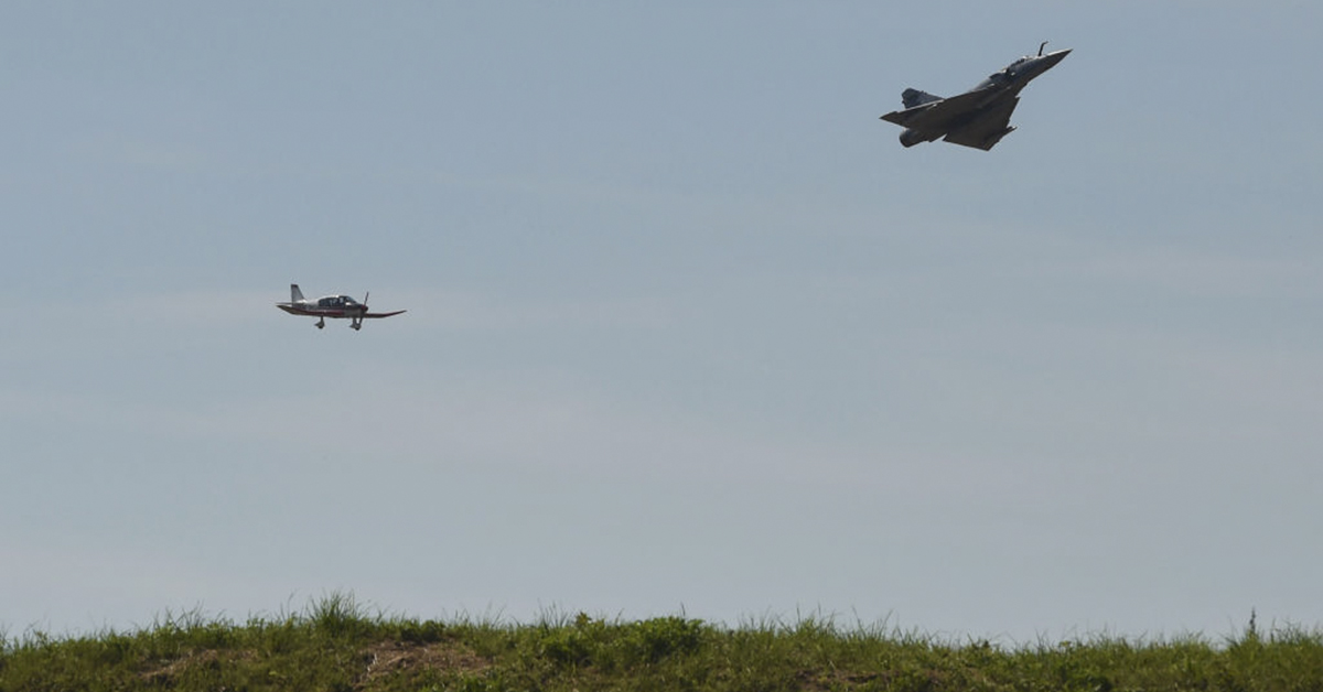 A mirage 2000-5 practices an exercise with a civilian airplane at the Luxeuil-Saint Sauveur air-base 116 in Saint-Sauveur, eastern France, on June 24, 2019. (SEBASTIEN BOZON/AFP/Getty Images)