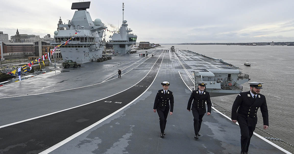 Crew members walk up the launching ramp on the flight deck of Britain's Royal Navy's HMS Prince of Wales, during a media opportunity whilst it's moored to the quayside in Liverpool, north west England on February 29, 2020. - HMS Prince of Wales, the second of the Royal Navy's QE Class aircraft carriers, is in Liverpool for a week-long visit. (PAUL ELLIS/AFP via Getty Images)