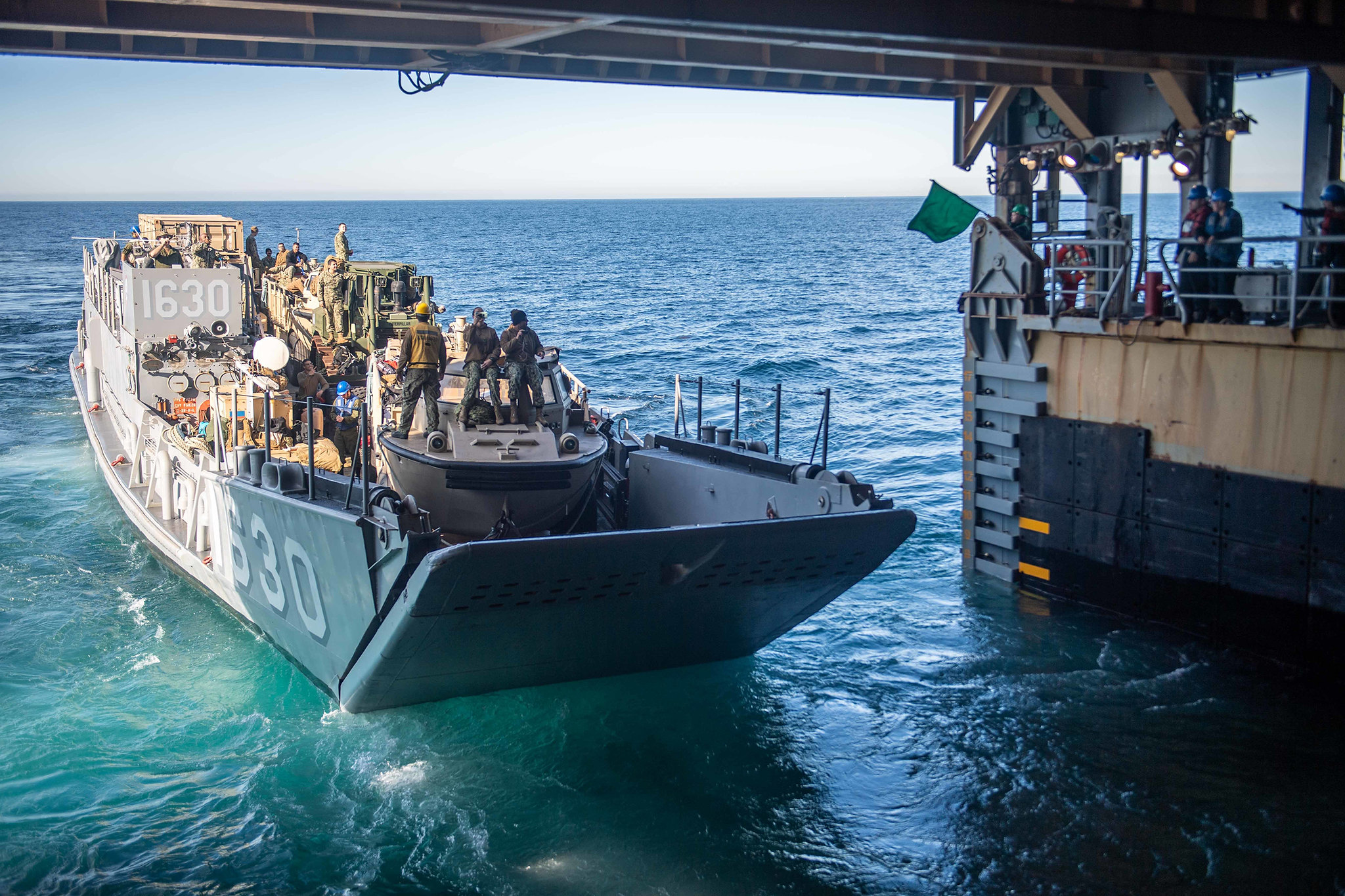 191124-N-HD110-1039\r\rPACIFIC OCEAN (Nov. 24, 2019) Landing Craft, Utility 1630, attached to Assault Craft Unit (ACU) 1, exits the well deck of the amphibious dock landing ship USS Harpers Ferry (LSD 49). Sailors and Marines of the Boxer Amphibious Ready Group (ARG) and the 11th Marine Expeditionary Unit (MEU) are embarked on Harpers Ferry for a regularly-scheduled deployment. (U.S. Navy photo by Mass Communication Specialist 3rd Class Danielle A. Baker)