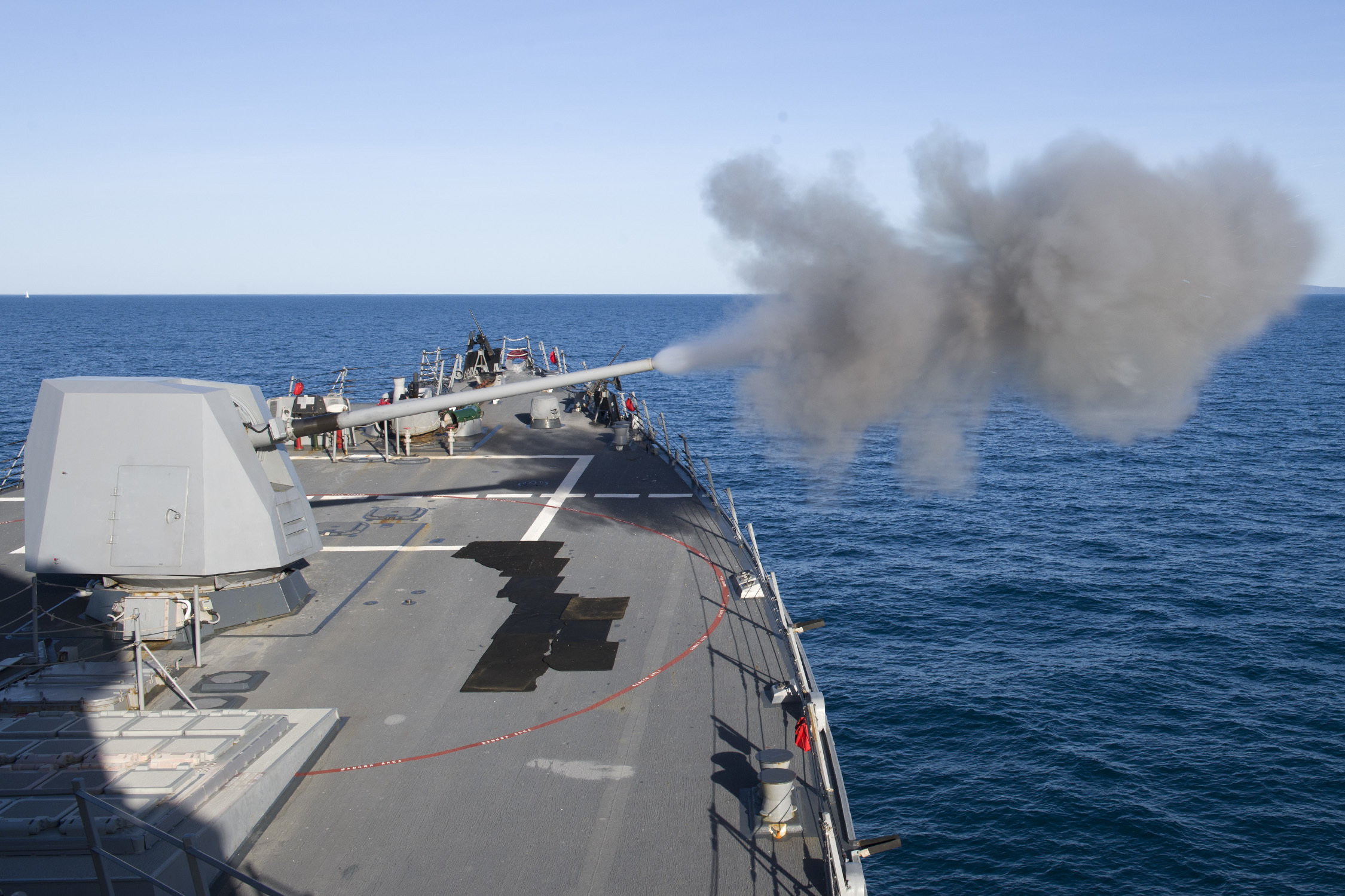 The U.S. guided-missile destroyer Sterett fires its MK 45 5-inch gun during a naval surface fire support exercise as part of Talisman Saber 17. Talisman Saber is a biennial U.S. and Australia bilateral exercise held off the coast of Australia meant to achieve interoperability and strengthen the alliance between the two countries. (MC1 Byron C. Linder/U.S. Navy)