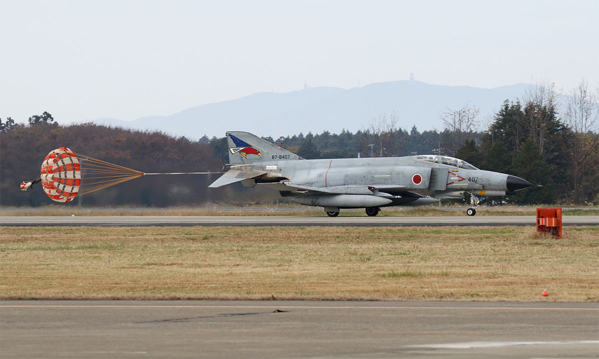 A Japan Air Self-Defense Force Mitsubishi F-4EJ Kai Phantom II of 302 Squadron lands at Hyakuri Air Base in early December 2018. The Phantoms of this squadron will soon be retired and replaced with the Lockheed Martin F-35A Lightning II Joint Strike Fighter. (Mike Yeo/Staff)