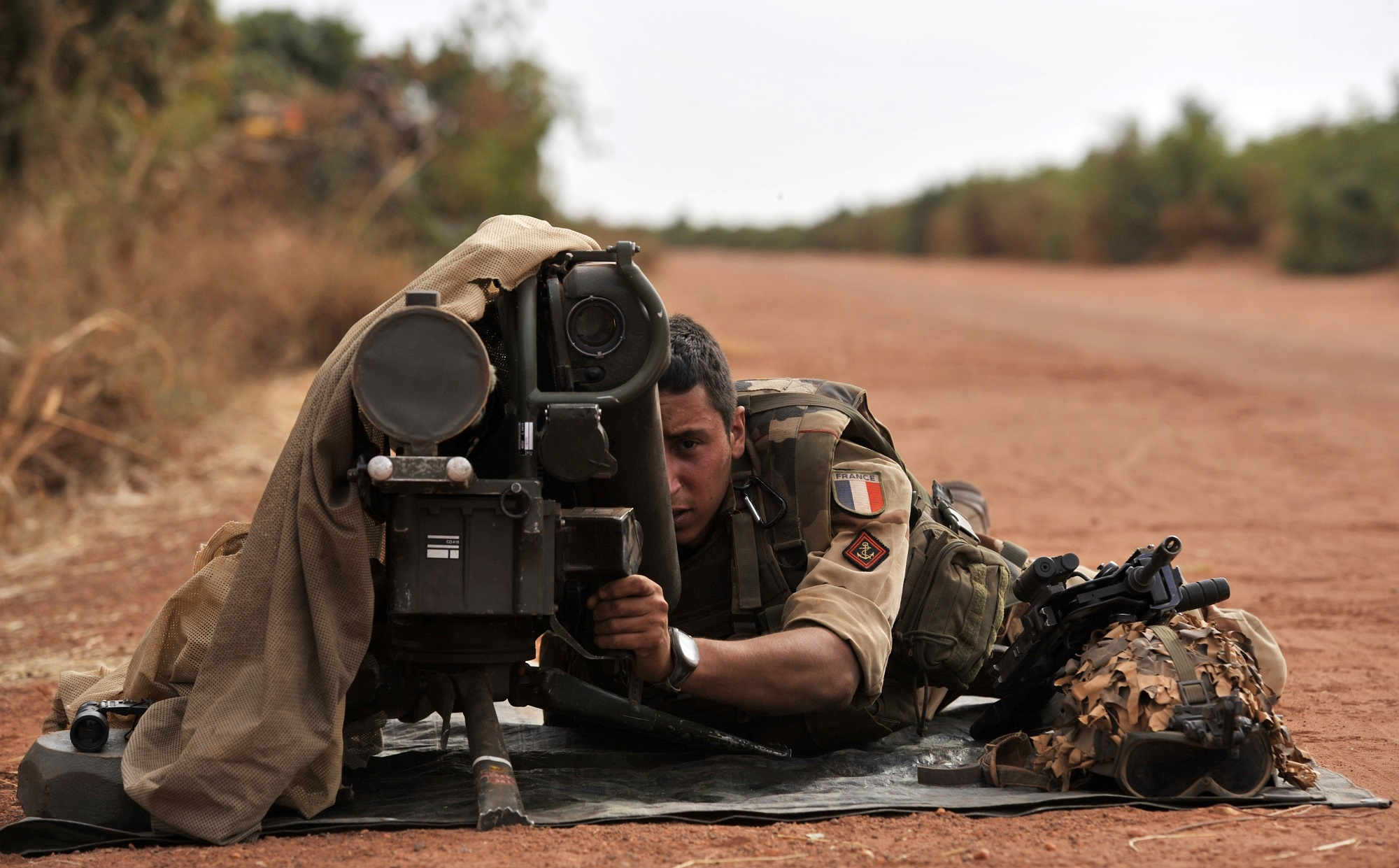 A French soldier lays with a Milan anti-tank missile launcher at the forward position near Diabaly, Mail, on Jan. 22, 2013. (Issouf Sanogo/AFP via Getty Images)