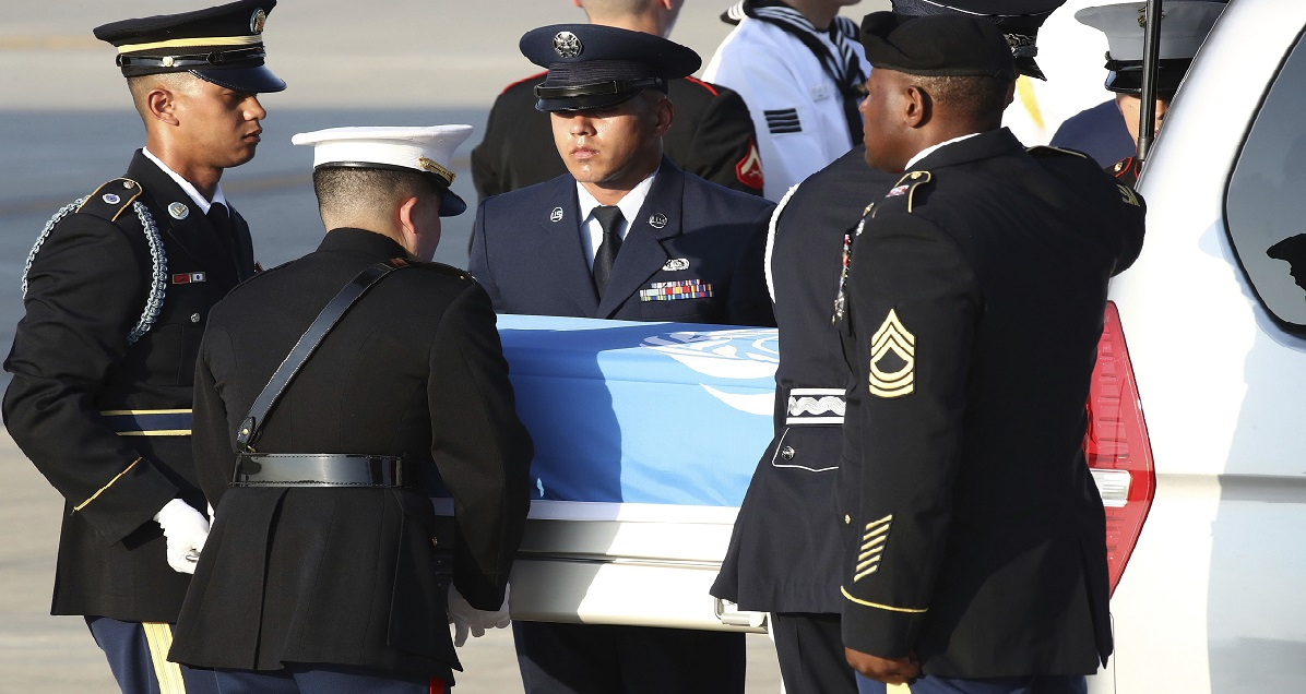U.N. honor guards carry the remains of U.S. servicemen killed in the Korean War and collected in North Korea, onto an aircraft at the Osan Air Base in Pyeongtaek, South Korea, Wednesday, Aug. 1, 2018. North Korea handed over 55 boxes of the remains last week as part of agreements reached during a historic June summit between its leader Kim Jong Un and U.S. President Donald Trump. (Chung Sung-Jun/Pool Photo via AP)
