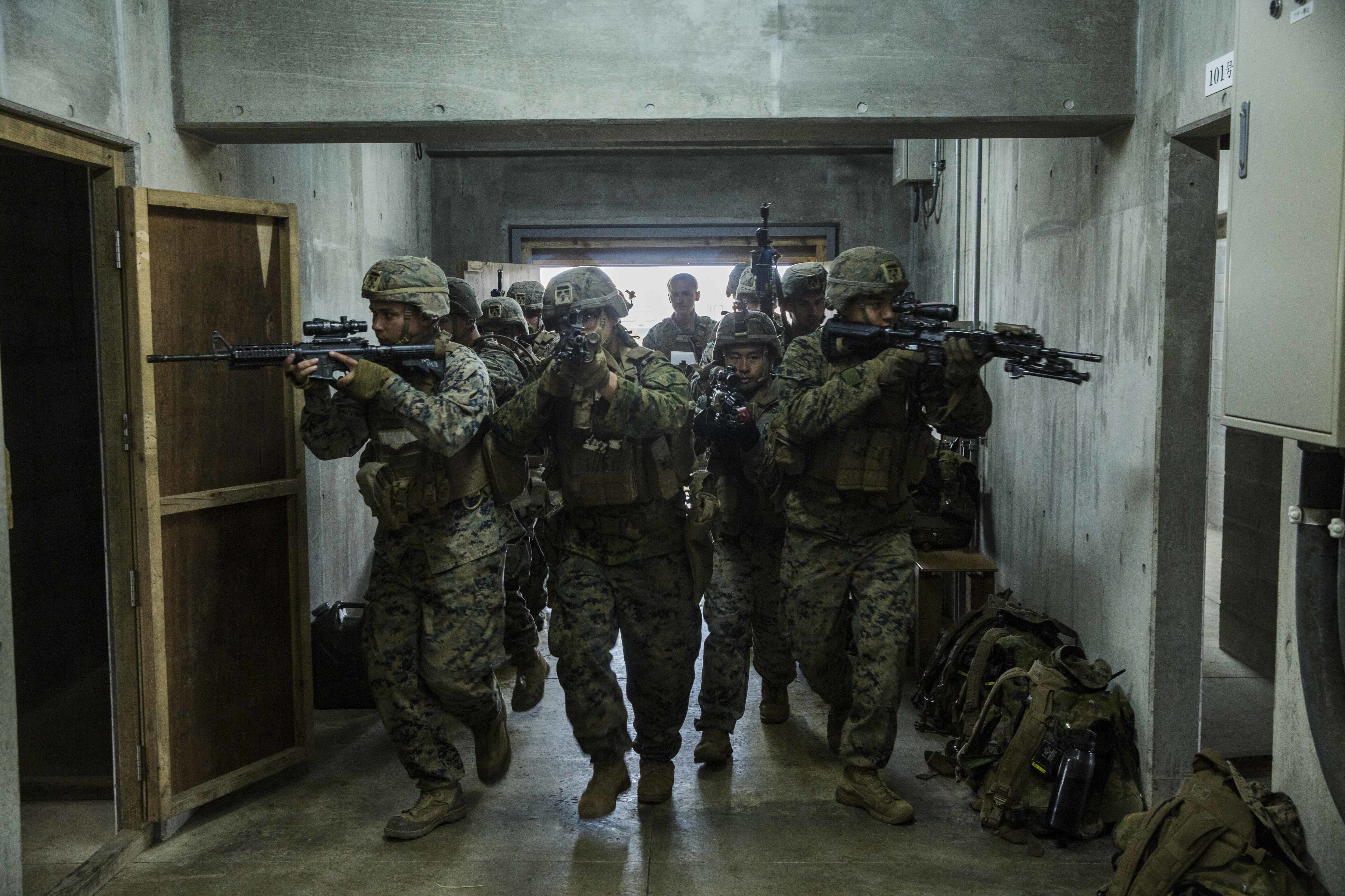 Marines show Japan Ground Self-Defense Force service members room-clearing techniques during Exercise Forest Light Western Army at Kirishima Maneuver Field, Kumamoto, Japan, Jan. 27, 2020. (Sgt. Audrey M. C. Rampton/Marine Corps)