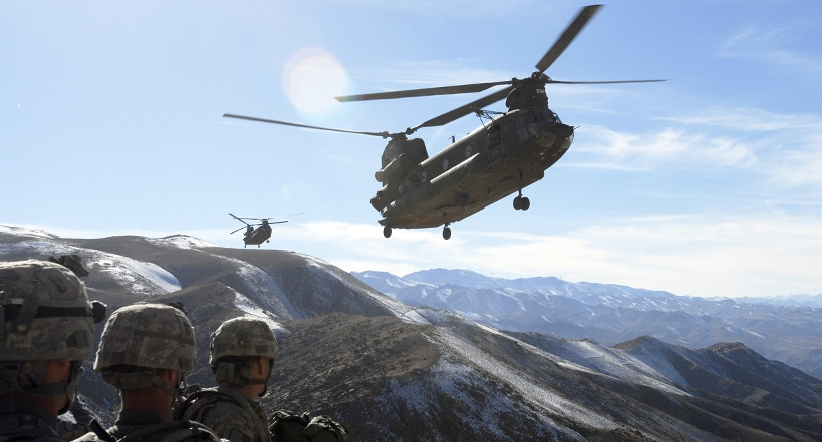 Soldiers with the 101st Airborne Division watch as two Chinook helicopters fly in to take them back to Bagram Air Field, Afghanistan Nov. 4, 2008. (Spc. Mary L. Gonzalez/Army)