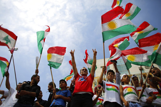 Kurds wave Kurdish flags and flash the victory sign as they gather to support next week's referendum in Iraq, at Martyrs Square in Downtown Beirut, Lebanon, Sunday, Sept. 17, 2017. Iraq's Kurdish region plans to hold the referendum to gauge support for independence from Iraq for the autonomous region on Sept. 25. (Hassan Ammar/AP)