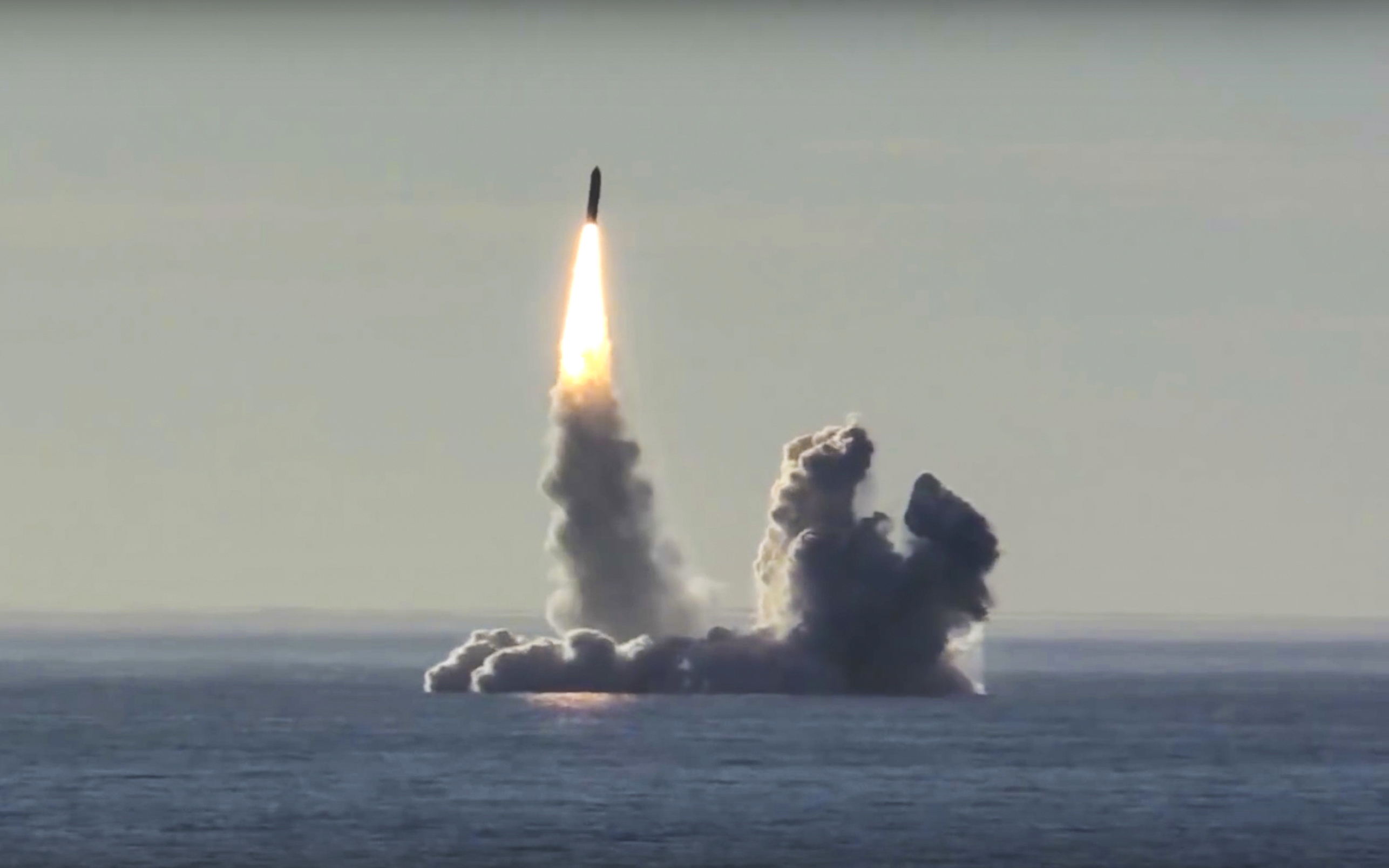 In this photo made from the footage taken from Russian Defense Ministry official web site on Thursday, May 24, 2018, the Russian nuclear submarine Yuri Dolgoruky test-fires the Bulava missiles from the White Sea. The exercise marked the first launch of four Bulava missiles in a single salvo. (AP Photo/Russian Defense Ministry Press Service)