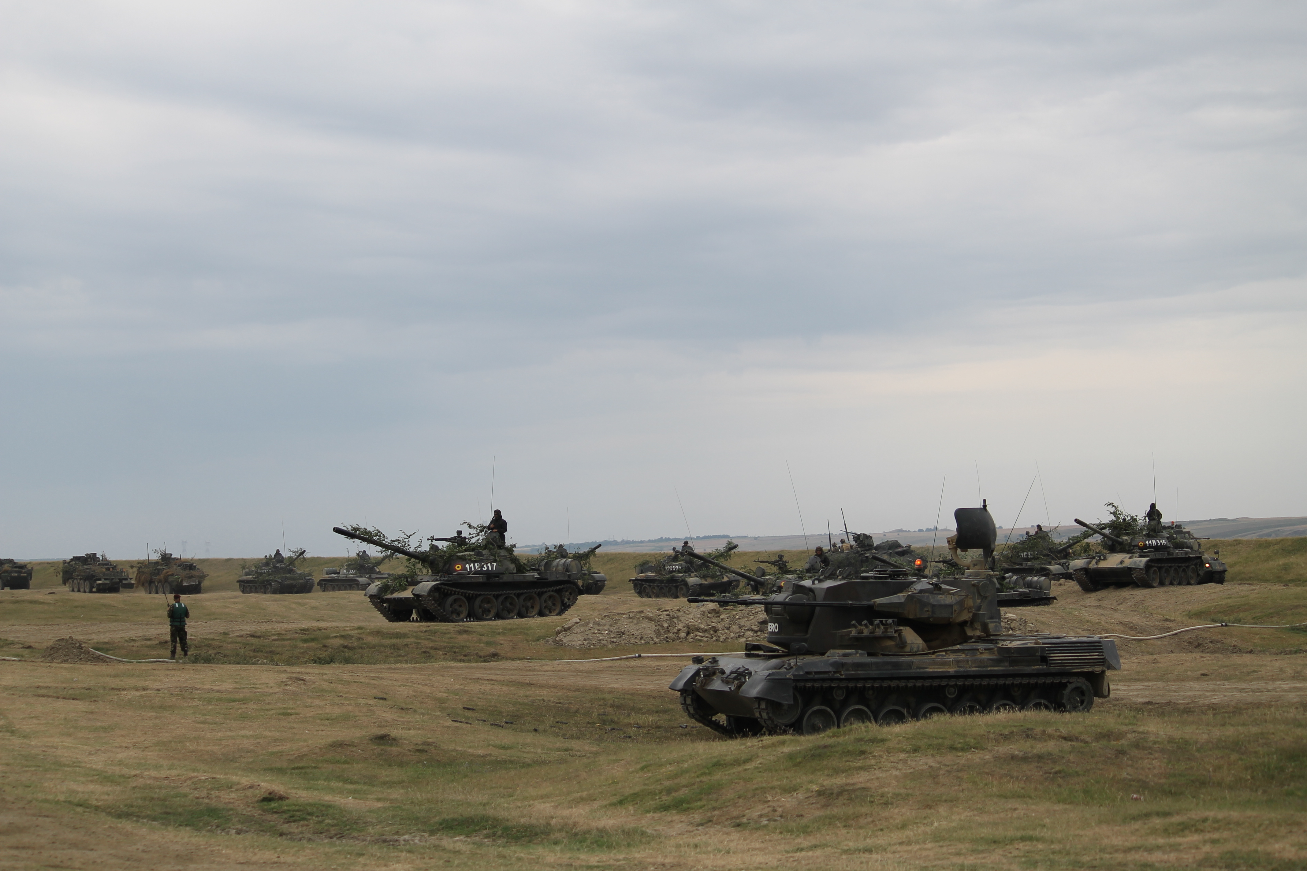 A Gepard in the foreground continues to scan the skies for threats while Romanian tanks and U.S. Strykers begin to line up on the beach in order to cross the bridge. (Jen Judson/Staff)