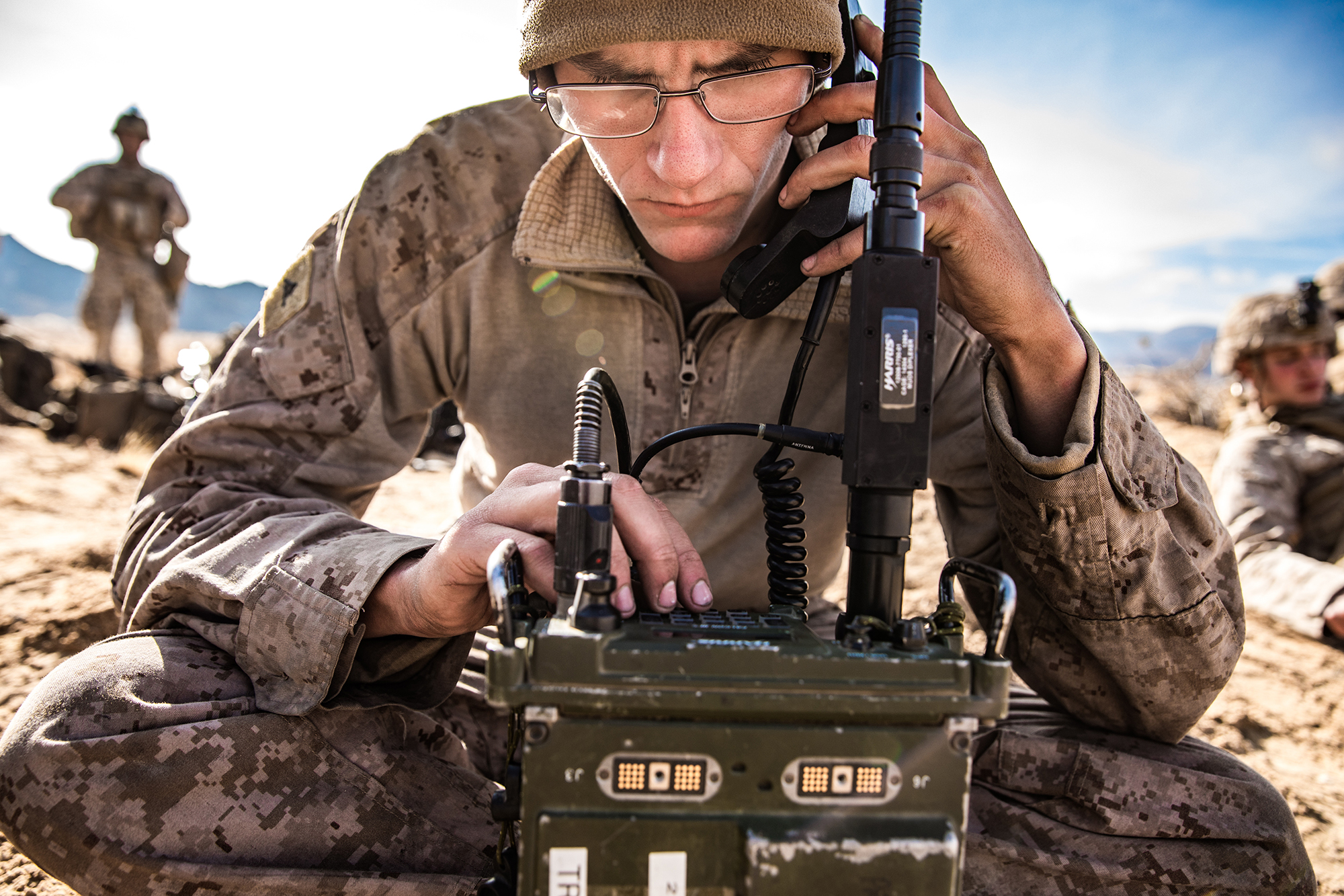 Marine Corps Lance Cpl. Zachary Cooper, a radio operator, uses the AN/PRC-117 Multiband Manpack Radio to set up communication during exercise Steel Knight (SK20) at Marine Corps Air Ground Combat Center Twentynine Palms, California, Dec. 5, 2019. (Cpl. Alexa M. Hernandez/Marine Corps)