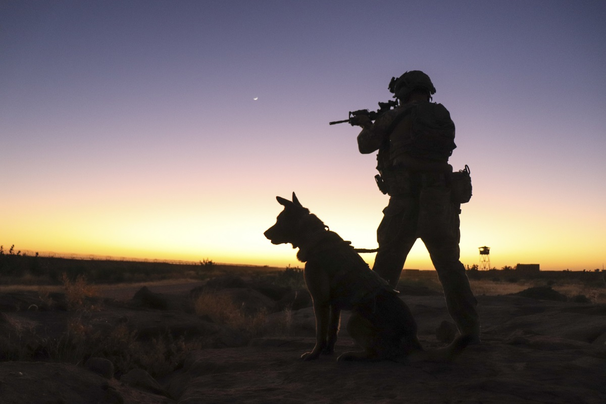 Senior Airman Cullen Thomas, 824th Expeditionary Base Defense Squadron military working dog handler, and his military working dog Klepa perform a perimeter check at Nigérien Air Base 201, Niger, Dec. 9, 2018. (Staff Sgt. Daniel Asselta/Air Force)