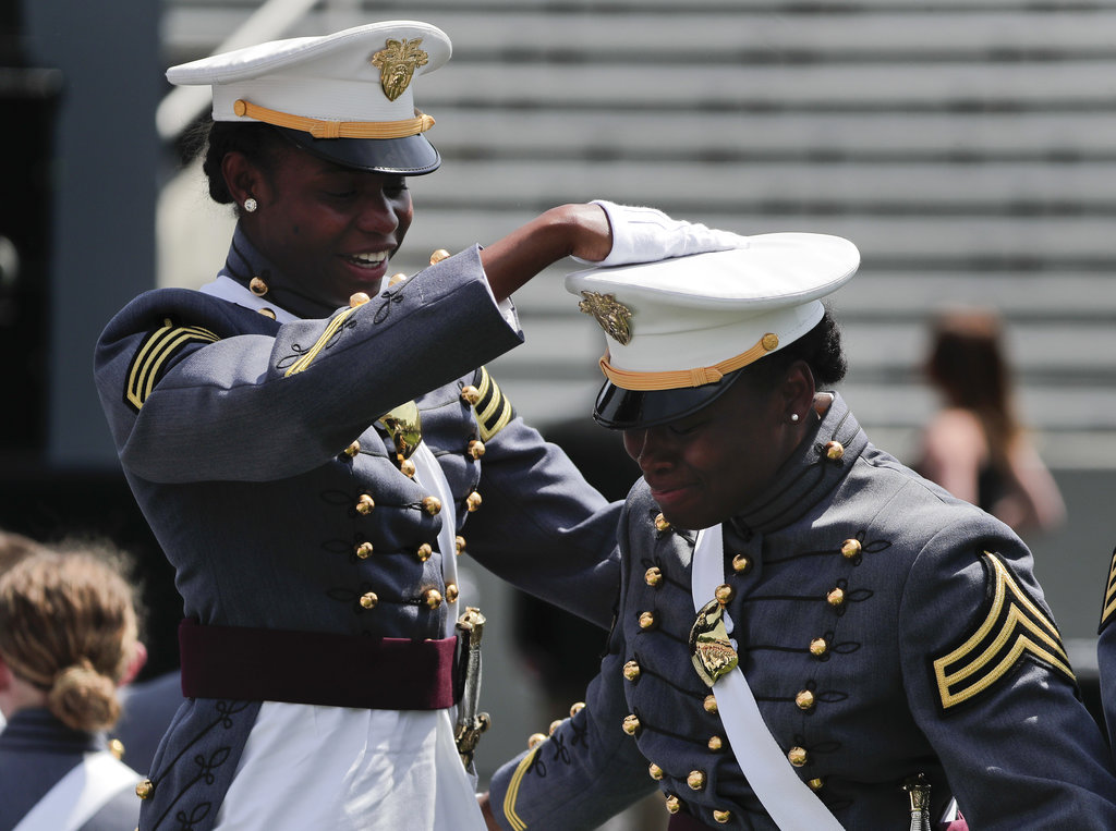 West Point cadets Camiesha Jackson, right, and Courtney Smith celebrate during graduation ceremonies at the United States Military Academy, Saturday, May 26, 2018, in West Point, N.Y. (AP Photo/Julie Jacobson)
