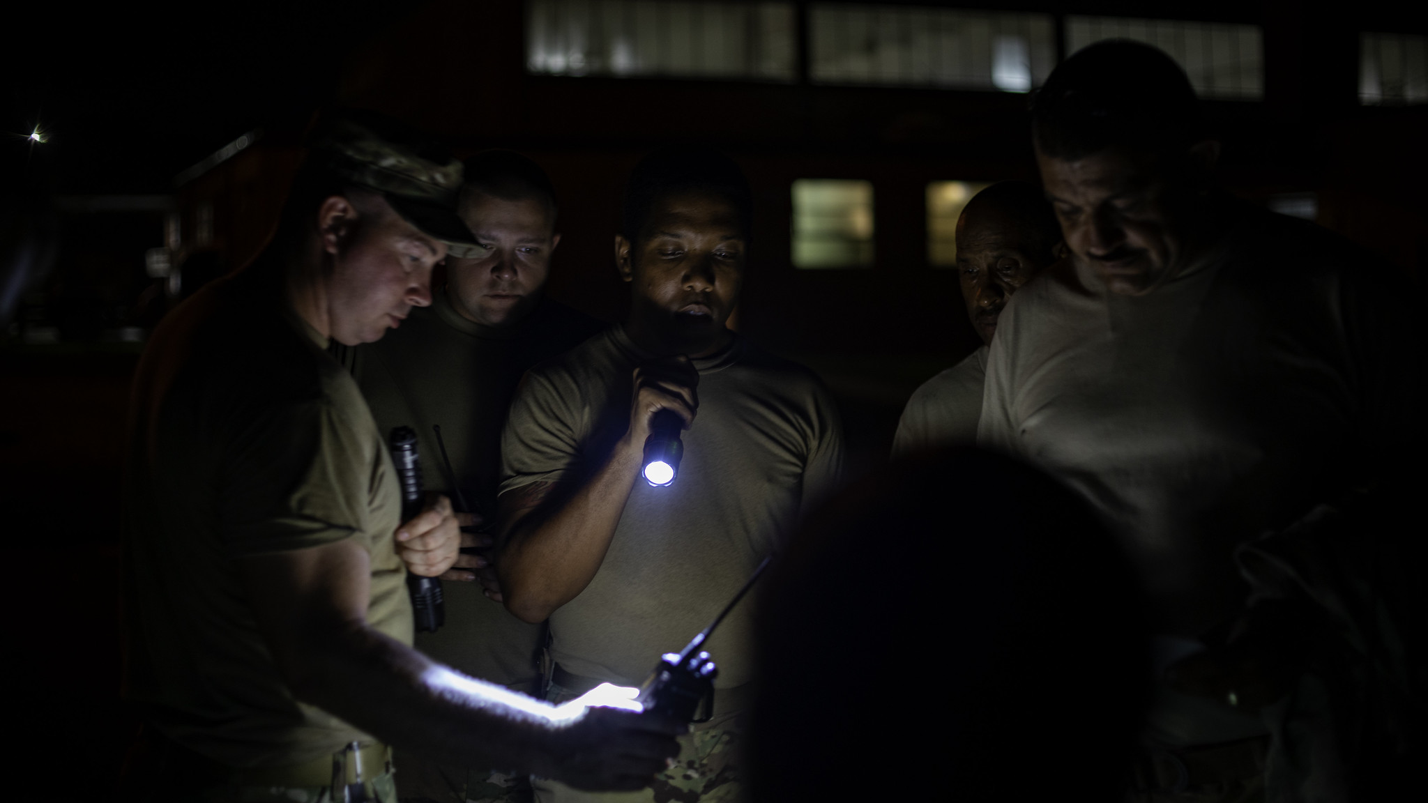 Staff Sgt. Robert Shook carries out radio checks Sept. 6, 2019, prior to transporting Light Medium Tactical Vehicles needed to cross flood waters in the Outer Banks of North Carolina. (Spc. Abraham Morlu/Army National Guard)