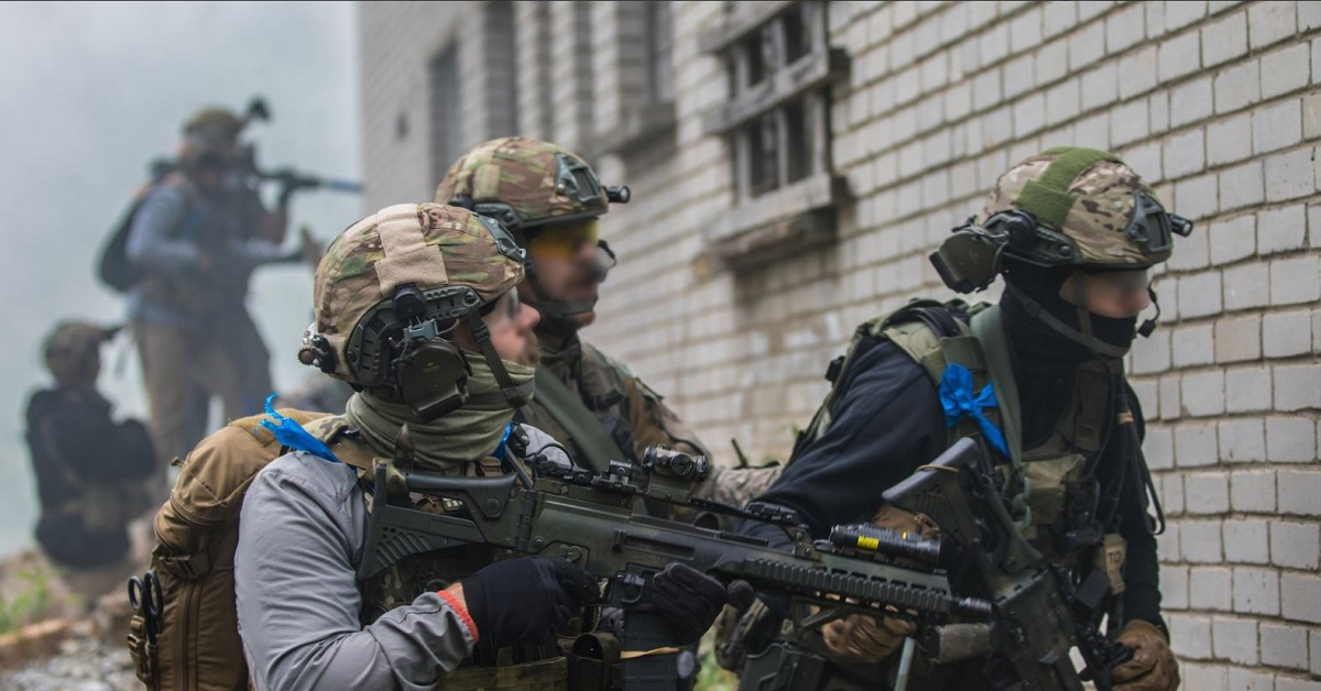 Estonian and U.S. special operations forces conduct a direct action mission during exercise Trojan Footprint 18 near Moe, Estonia, on June 2. The presence of U.S. forces in the Baltic states has irritated Russian leadership and created a situation ripe for information warfare. (U.S. Special Operations Command Europe)