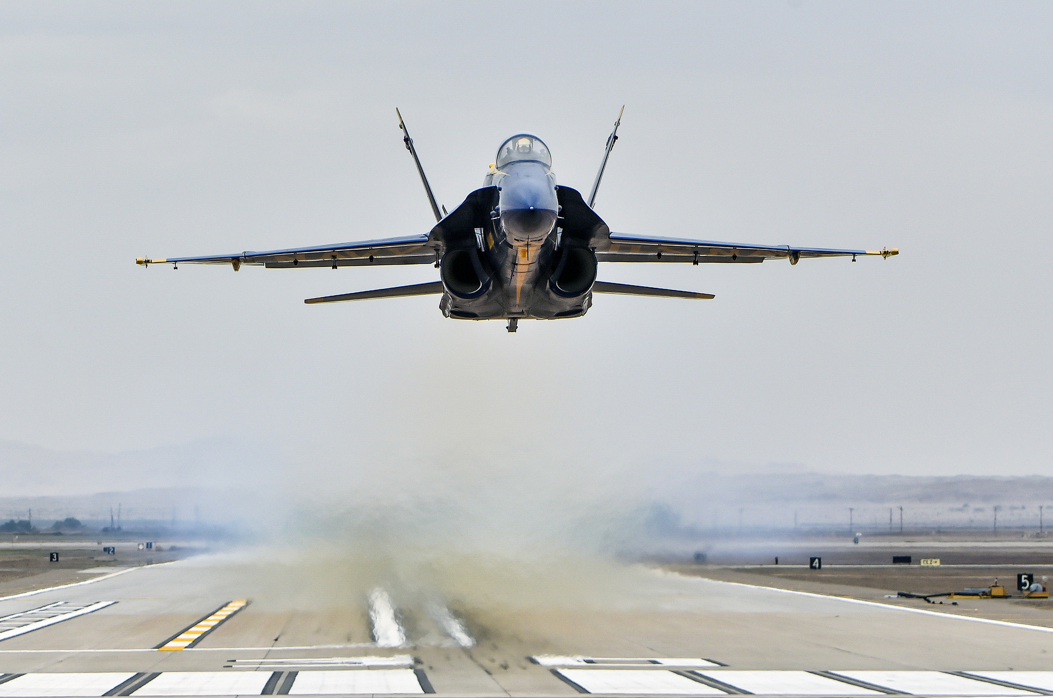 Opposing solo pilot Lt. Cmdr. Andre Webb, assigned to the U.S. Navy Flight Demonstration Squadron, the Blue Angels, performs a low transition take off during a practice demonstration on Feb. 2, 2019, at Naval Air Facility El Centro, Calif. (Mass Communication Specialist 2nd Class Timothy Schumaker/Navy)
